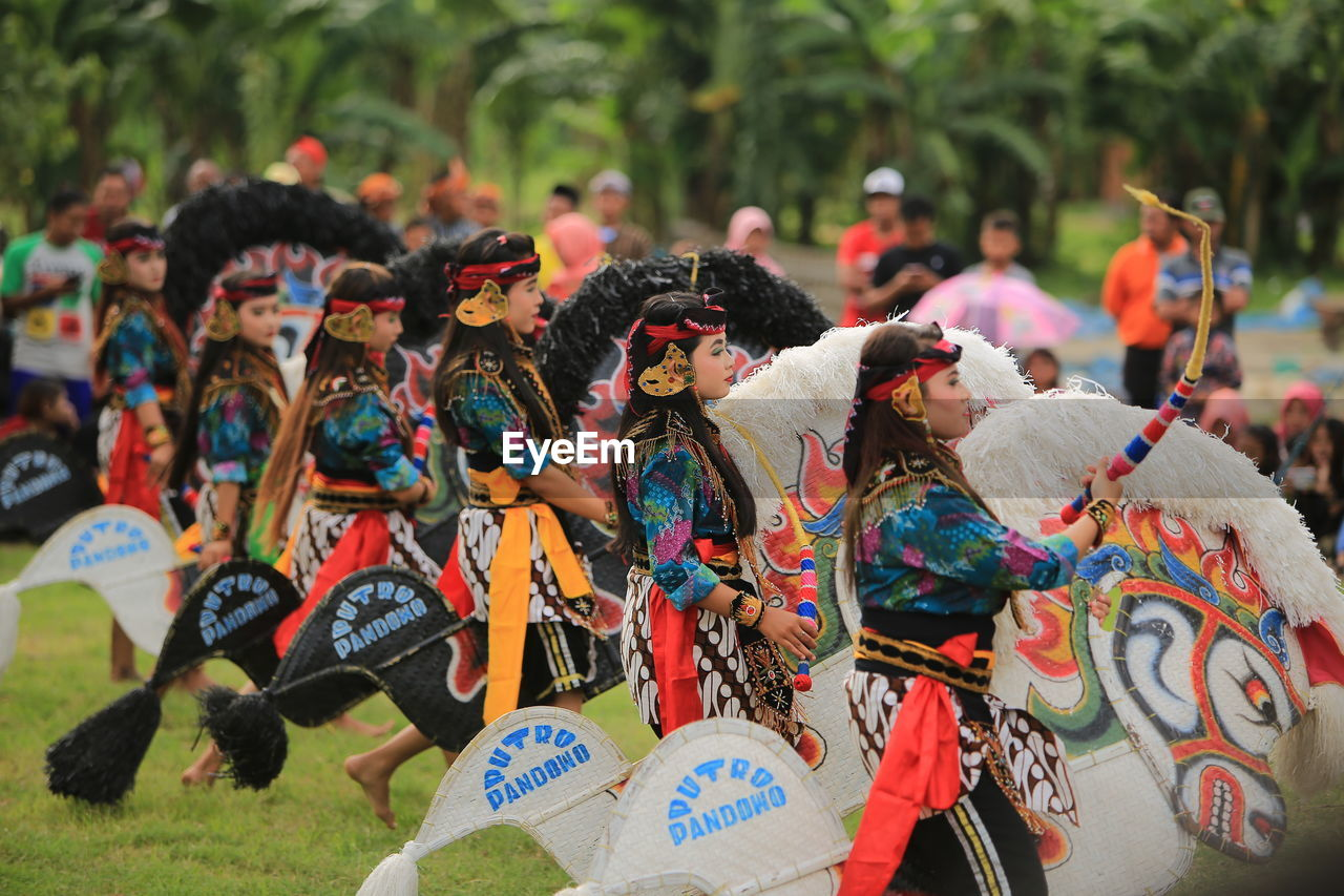 large group of people, group of people, crowd, real people, day, celebration, arts culture and entertainment, lifestyles, men, multi colored, focus on foreground, outdoors, dancing, leisure activity, creativity, women, representation, festival