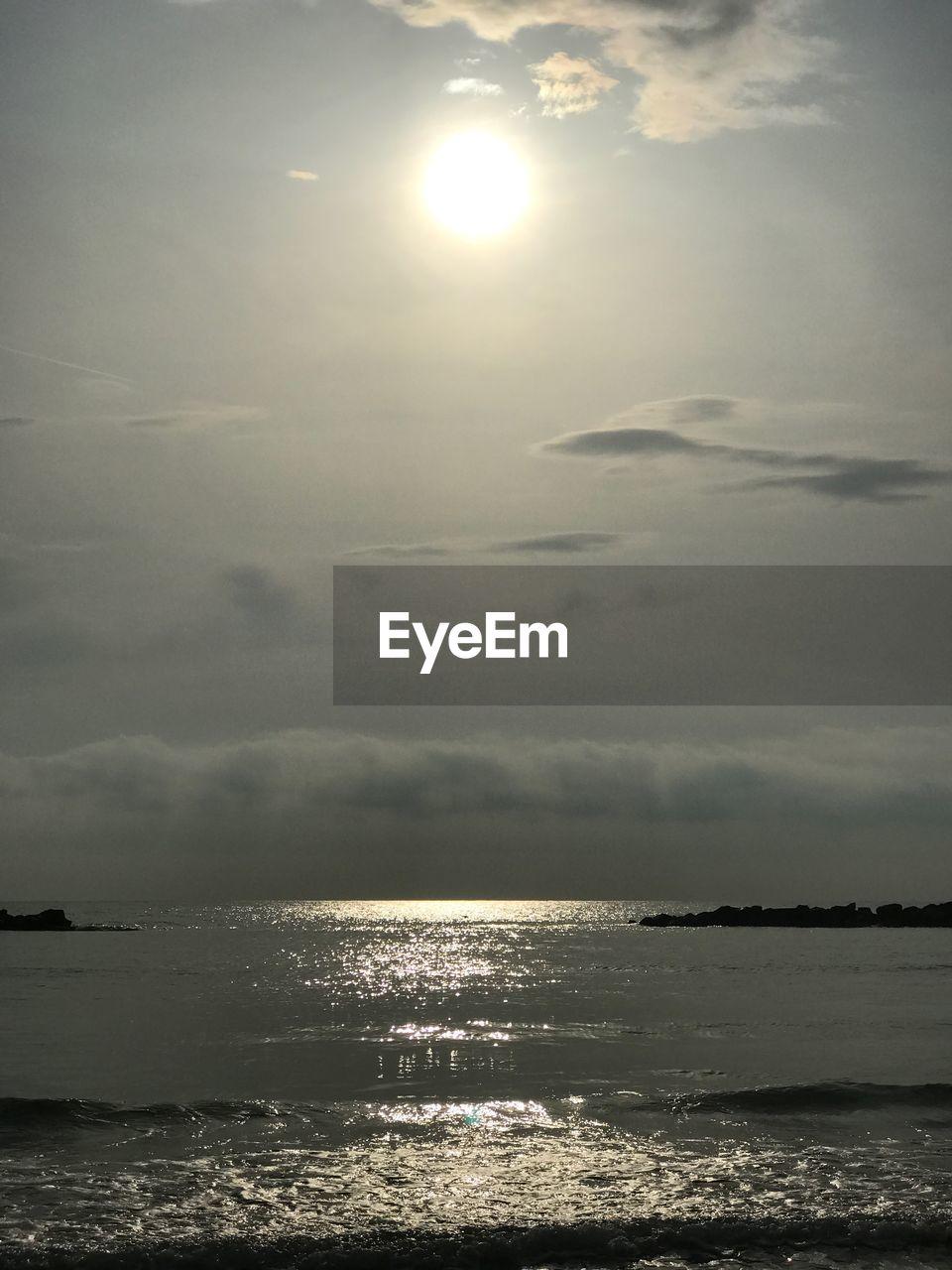 sky, sea, water, scenics - nature, beauty in nature, horizon over water, horizon, cloud - sky, tranquility, sunlight, tranquil scene, nature, sun, land, beach, idyllic, no people, outdoors, reflection, moonlight