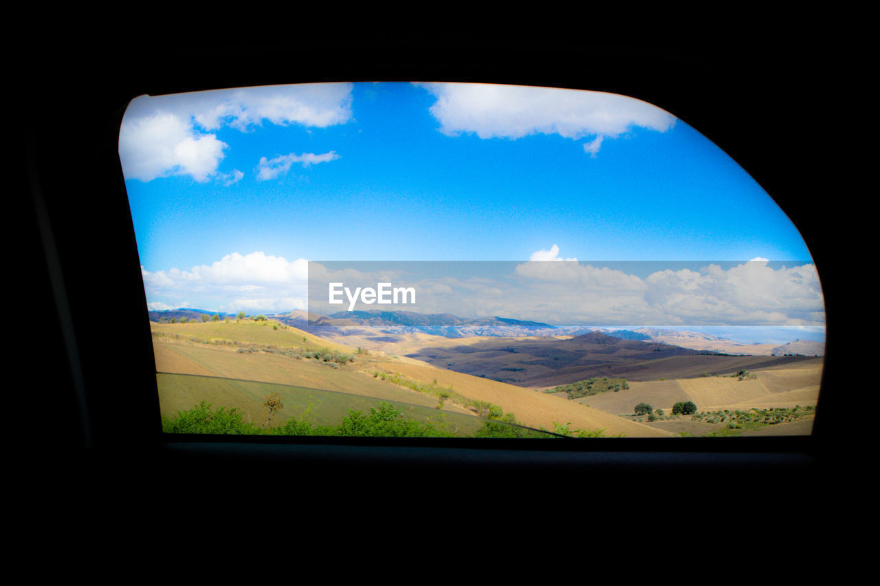 sky, cloud - sky, landscape, environment, window, transparent, beauty in nature, nature, no people, vehicle interior, scenics - nature, glass - material, land, indoors, field, transportation, day, tranquil scene, travel