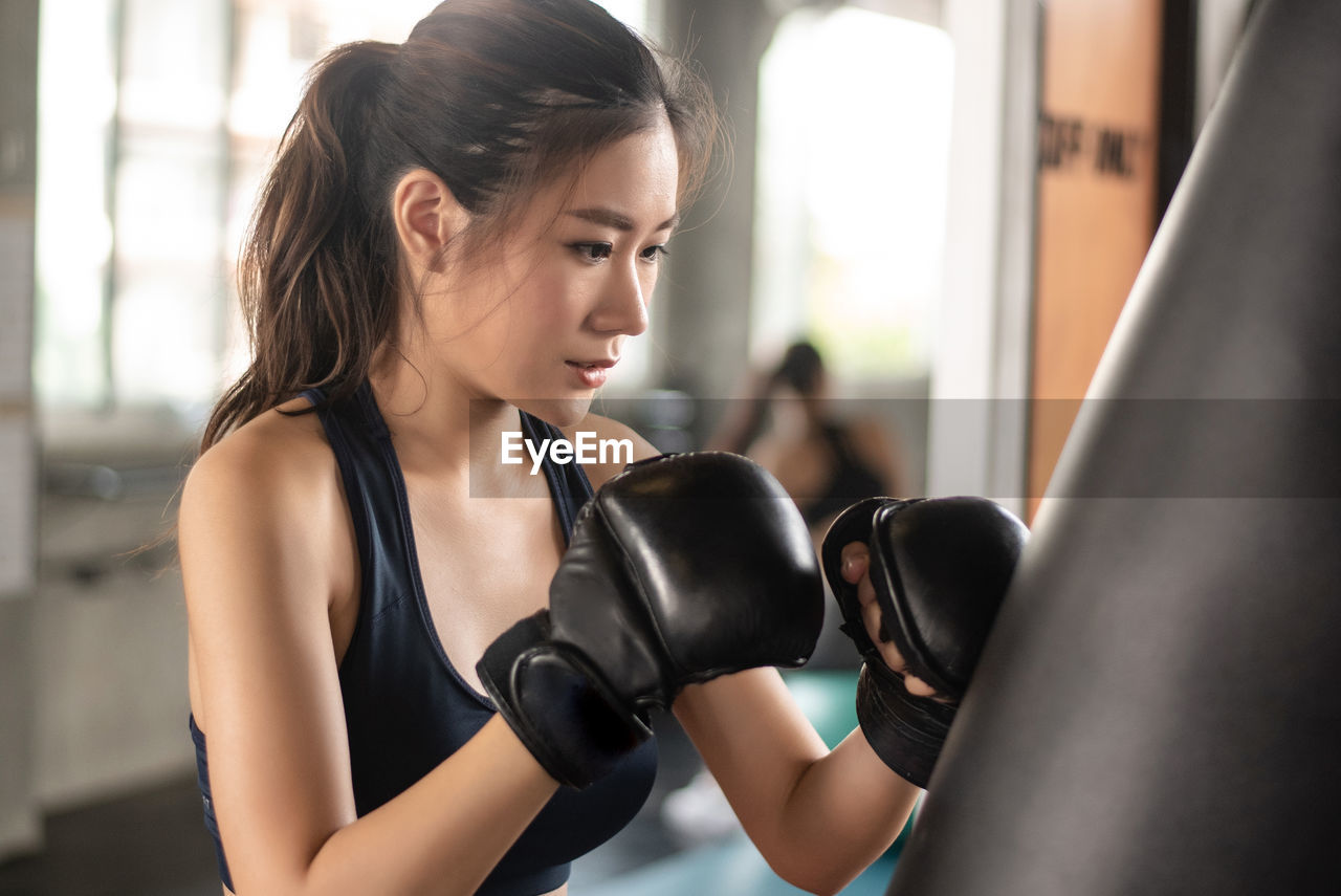 Determined Woman Boxing At Gym