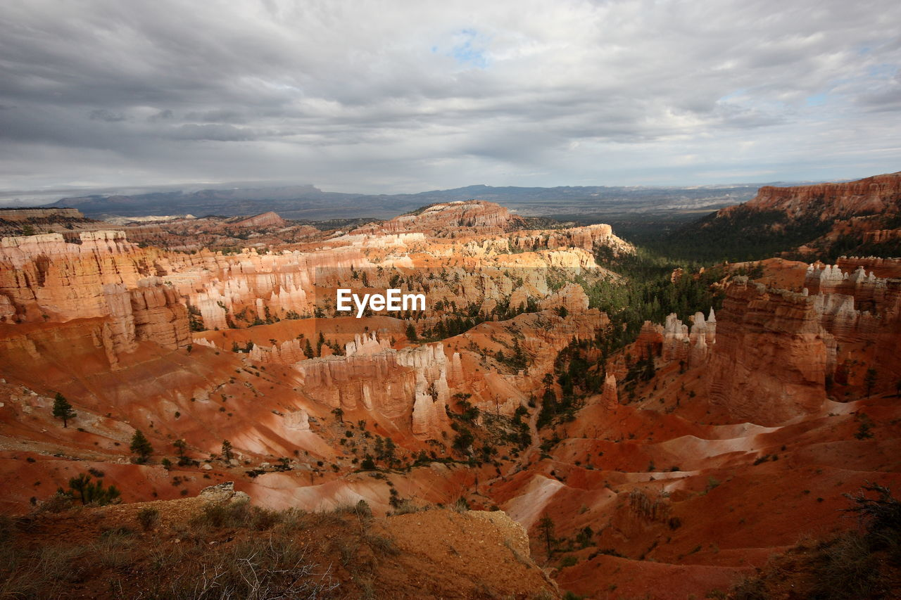 cloud - sky, beauty in nature, scenics - nature, tranquil scene, tranquility, non-urban scene, rock, rock formation, rock - object, landscape, physical geography, sky, environment, no people, travel destinations, canyon, nature, travel, remote, geology, eroded, climate, arid climate, formation