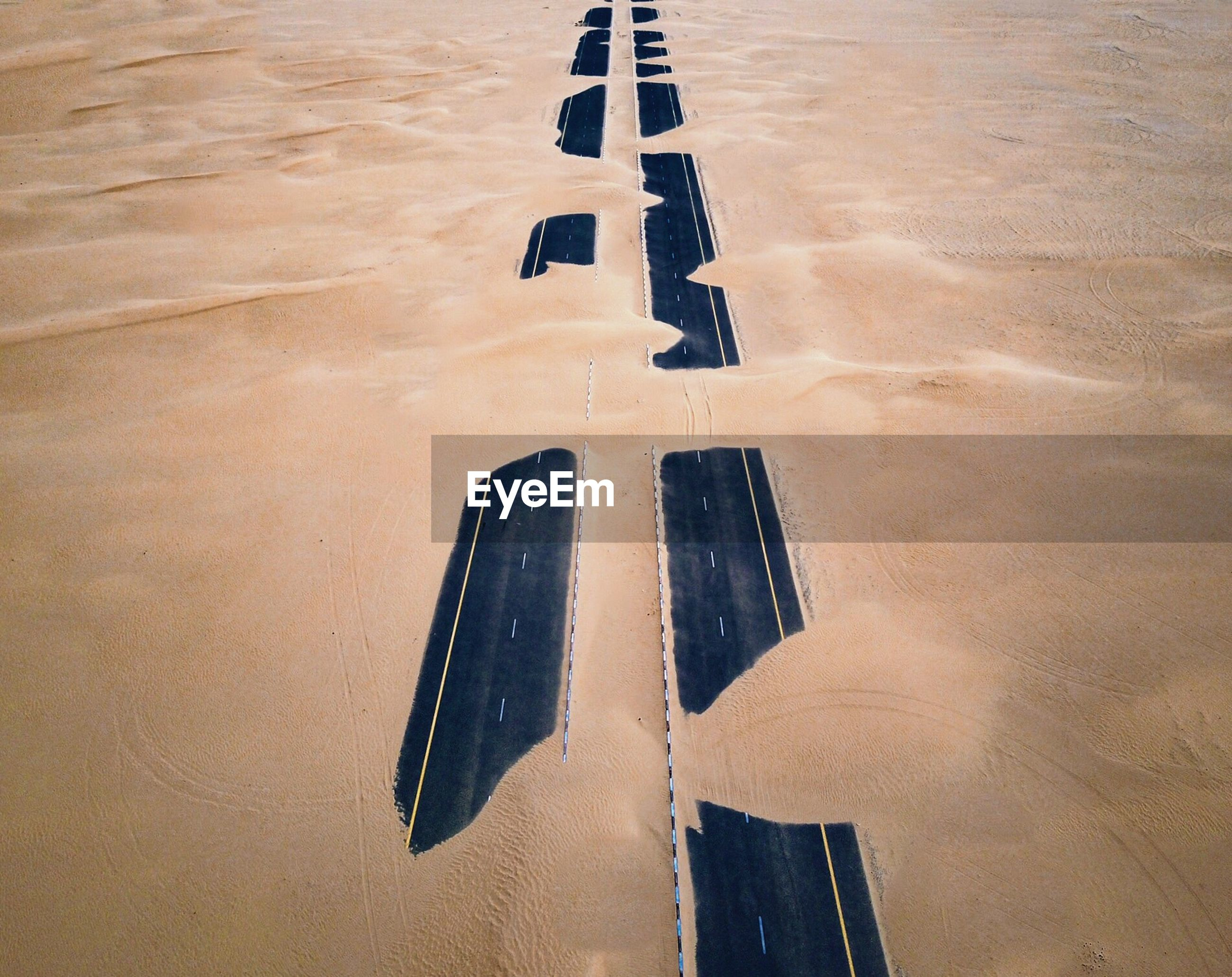 High angle view of two lane road in desert