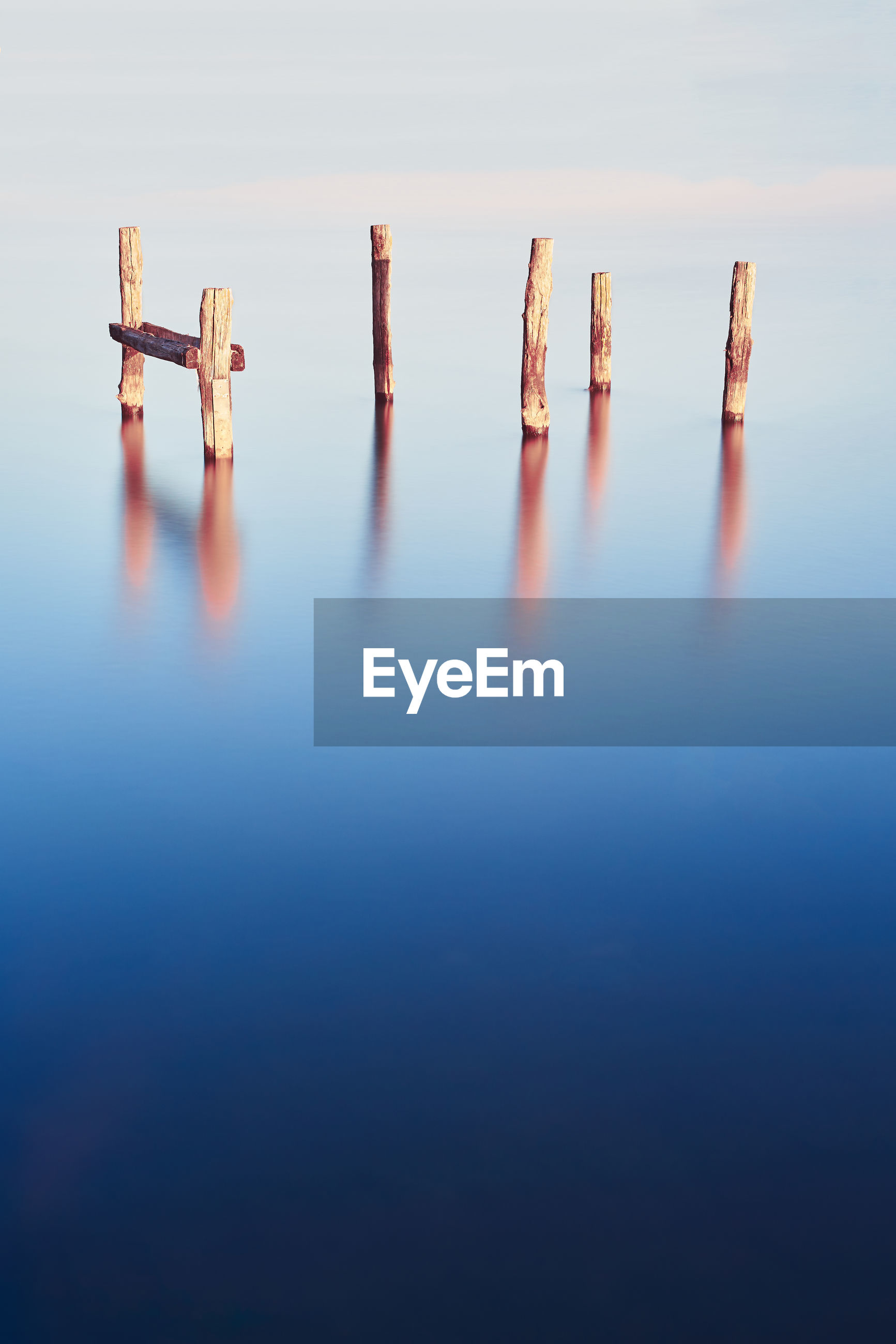 Wooden poles in the water with long exposure