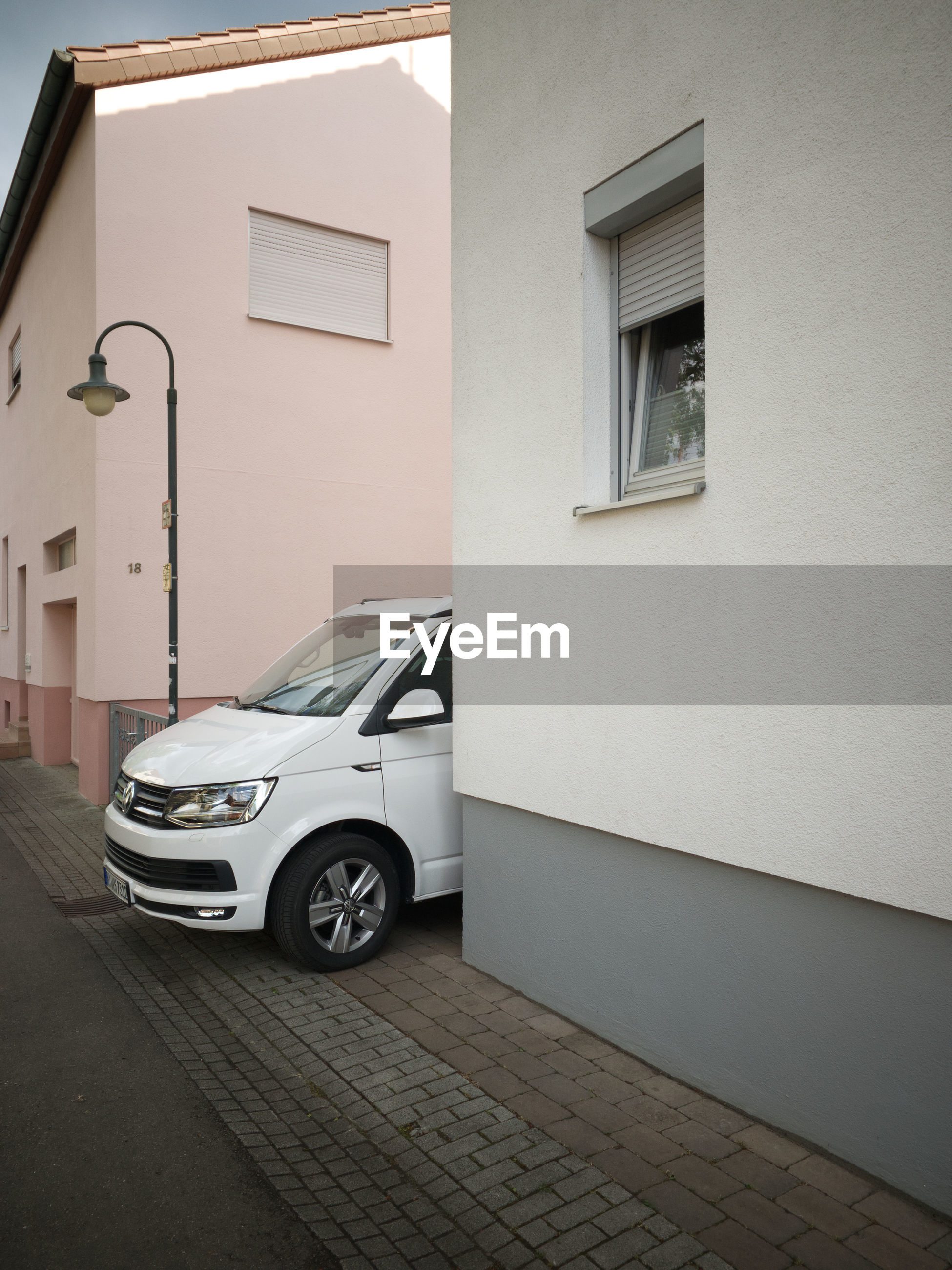 CAR ON STREET BY BUILDING