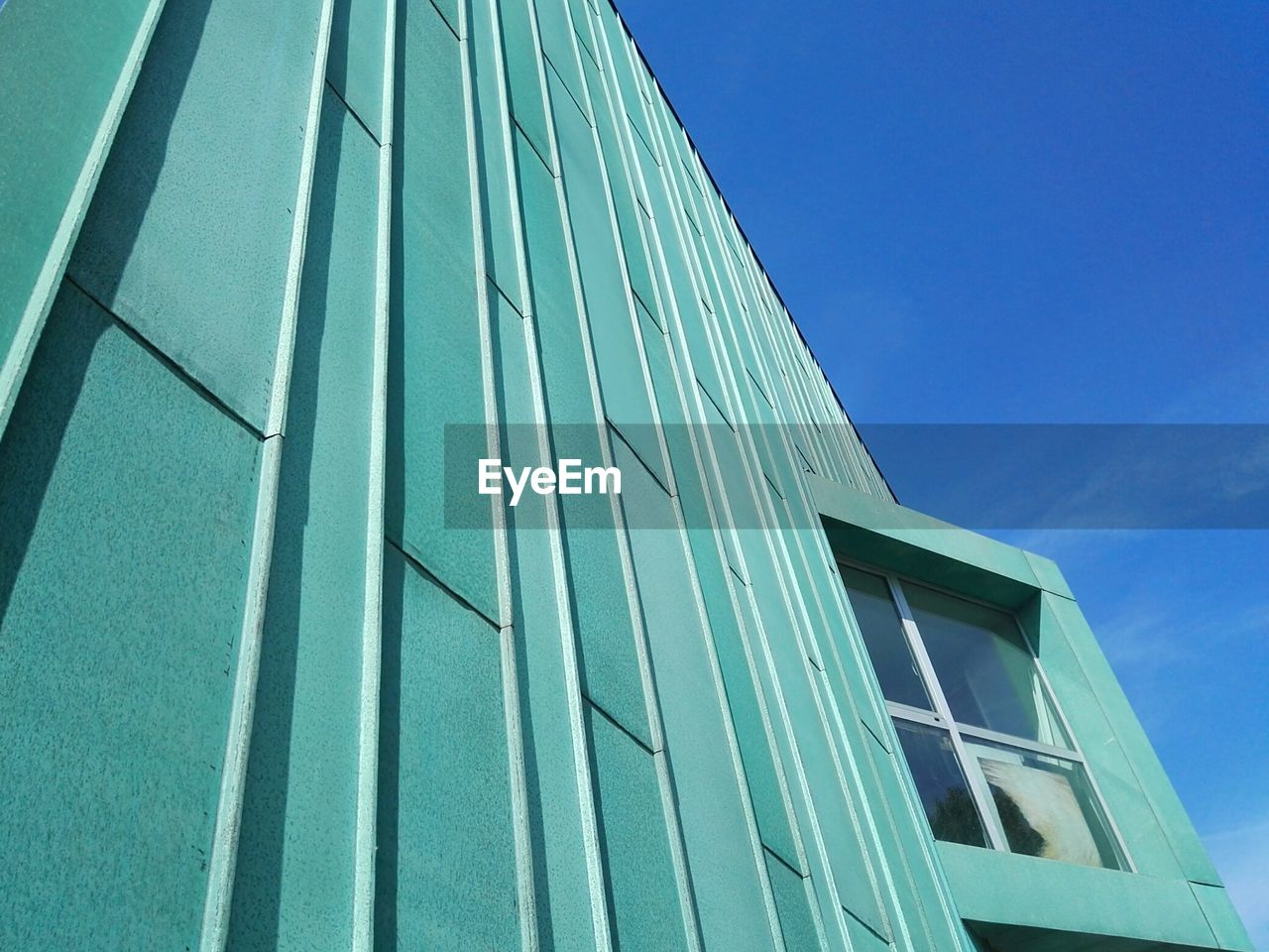 architecture, low angle view, building exterior, built structure, window, blue, day, modern, outdoors, no people, sky, city