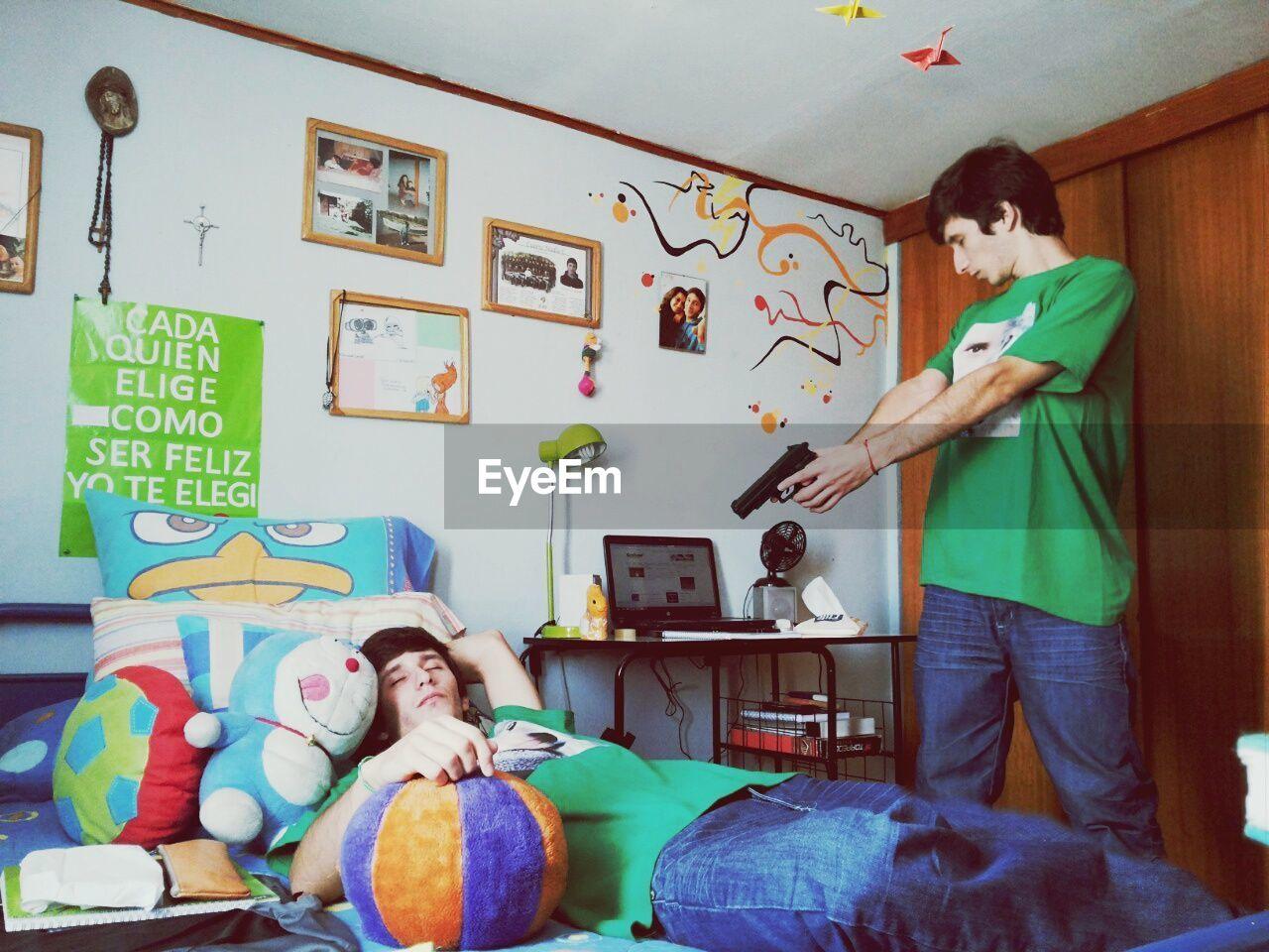 Digital Composite Image Of Man Shooting Self In Bedroom