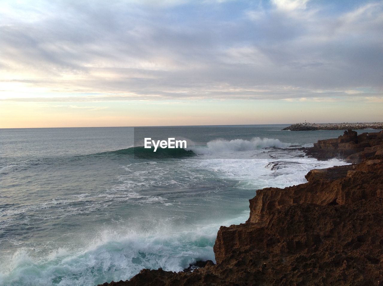 sea, water, sky, beauty in nature, scenics - nature, horizon over water, cloud - sky, beach, horizon, land, motion, rock, sunset, wave, nature, rock - object, aquatic sport, tranquility, tranquil scene, no people, outdoors, power in nature, rocky coastline
