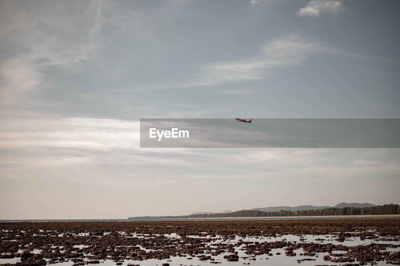 KITE FLYING OVER LAND