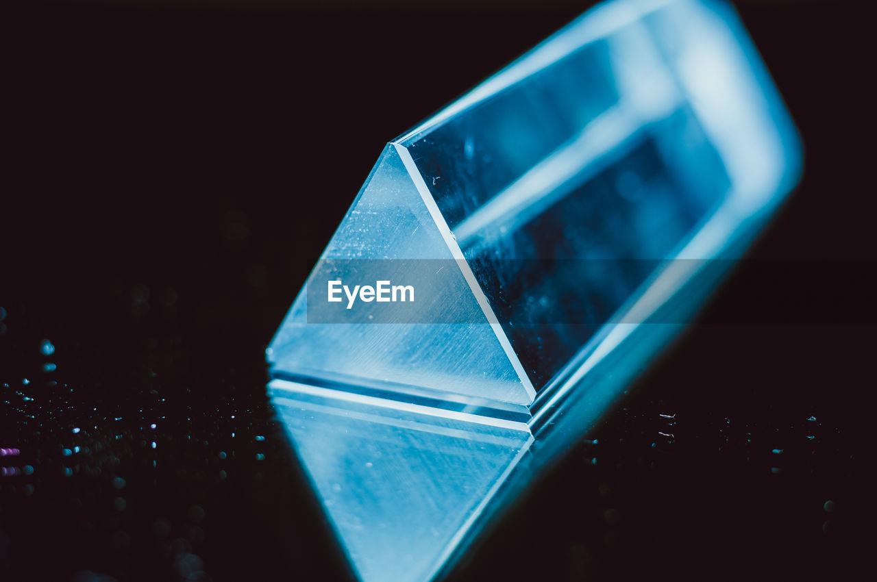 Close-up of prism against black background