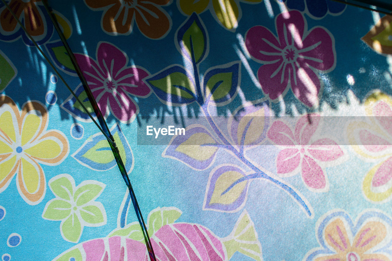 floral pattern, multi colored, pattern, blue, day, indoors, flower, no people, close-up