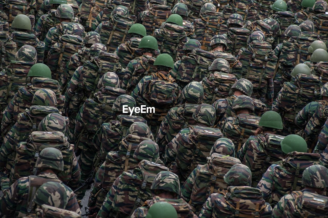 Rear View Of Army Soldiers At Parade