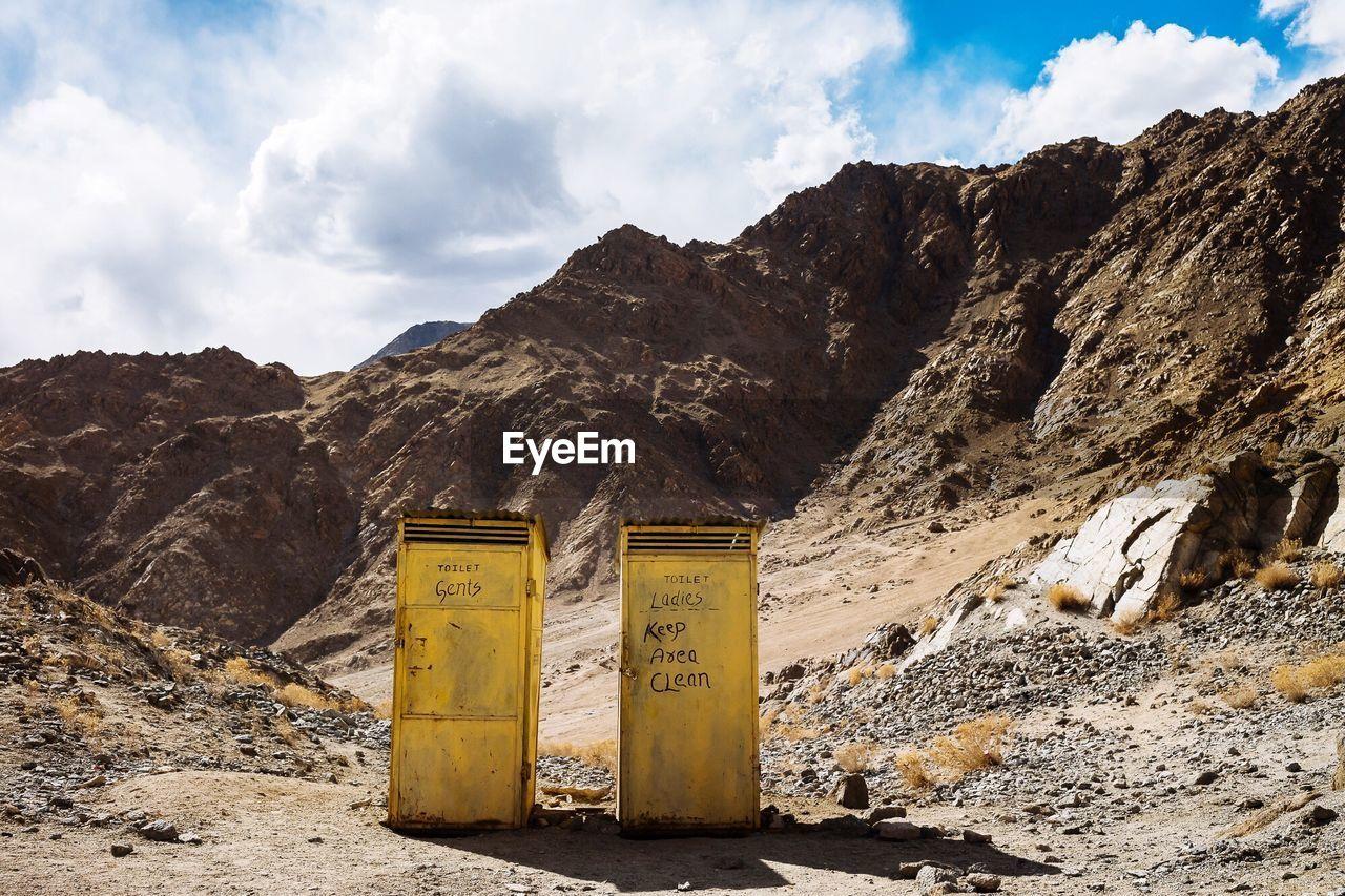 Portable Toilets On Mountain Against Sky