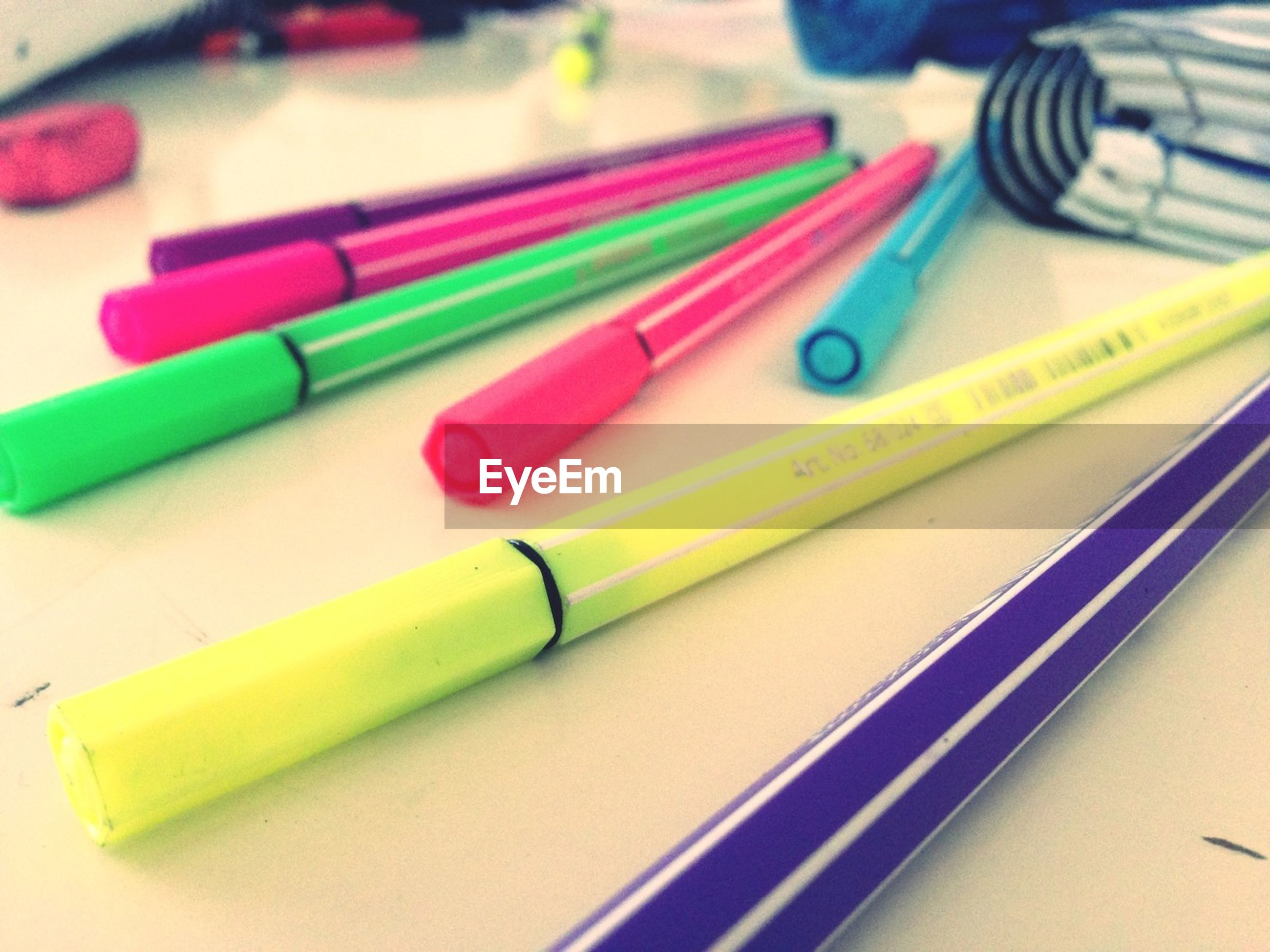 indoors, multi colored, still life, pencil, variation, close-up, colored pencil, large group of objects, pen, colorful, choice, education, high angle view, office supply, plastic, studio shot, writing instrument, no people, table, yellow