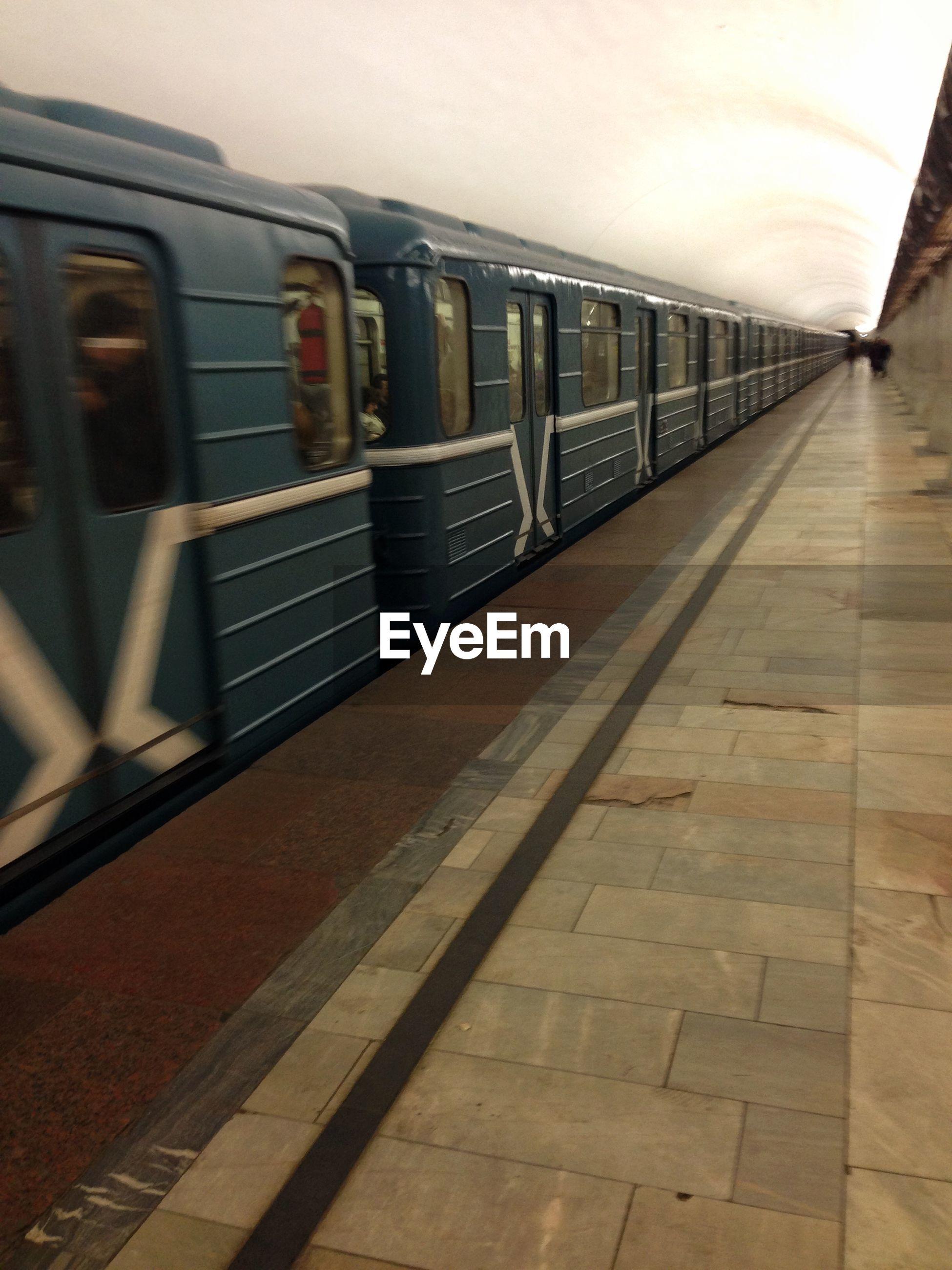 Blurred motion of train at platform