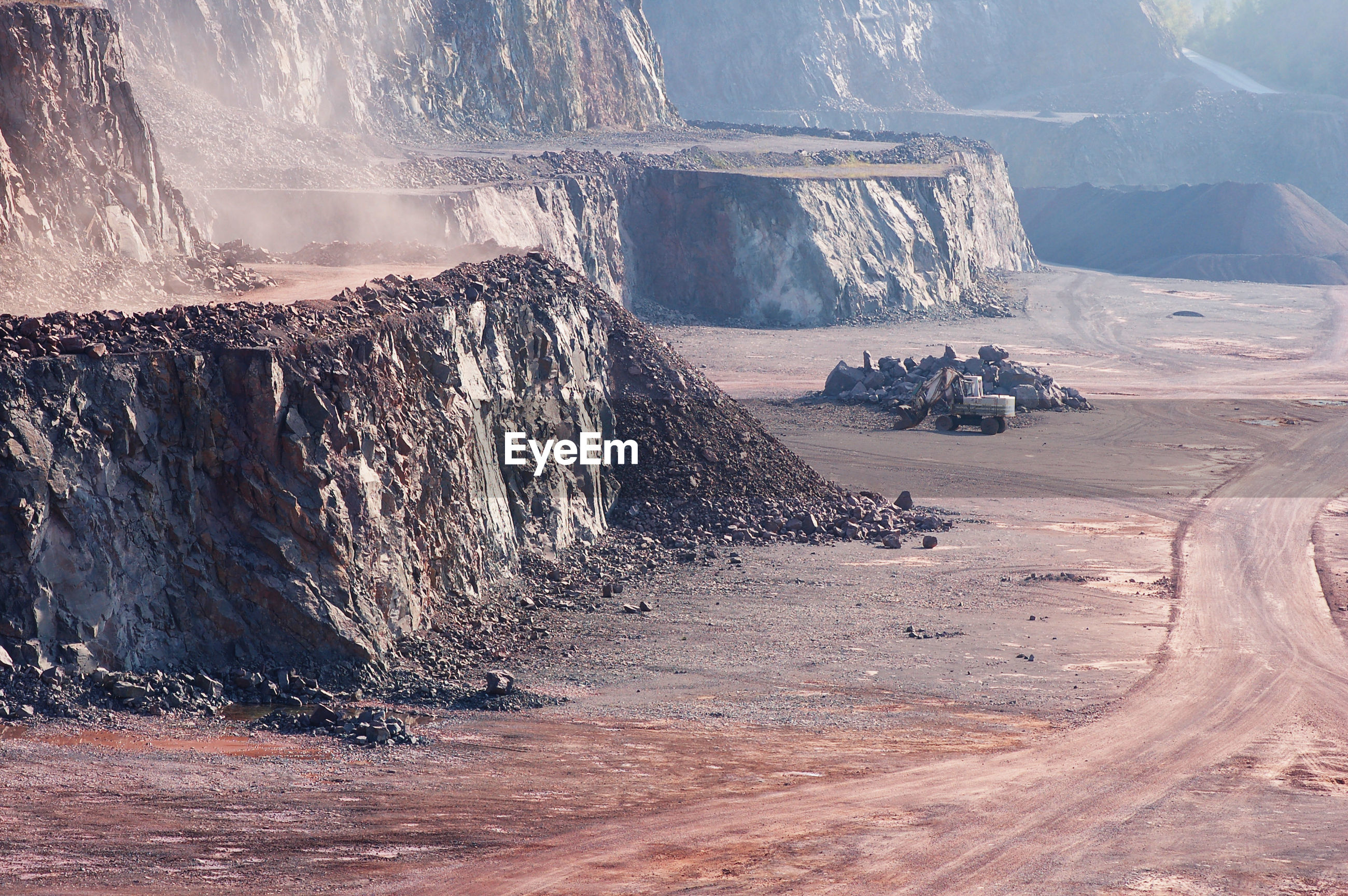 Empty open-pit mining against sky