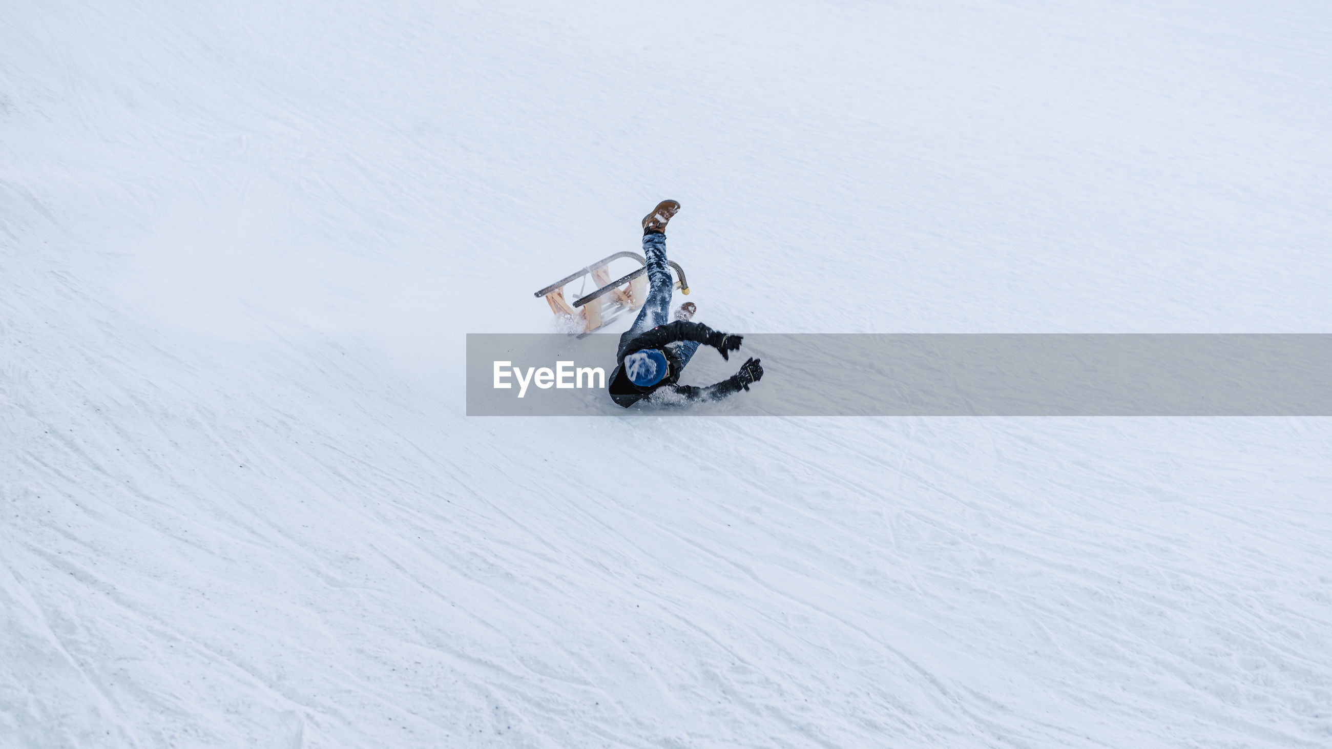 Man falling on slope
