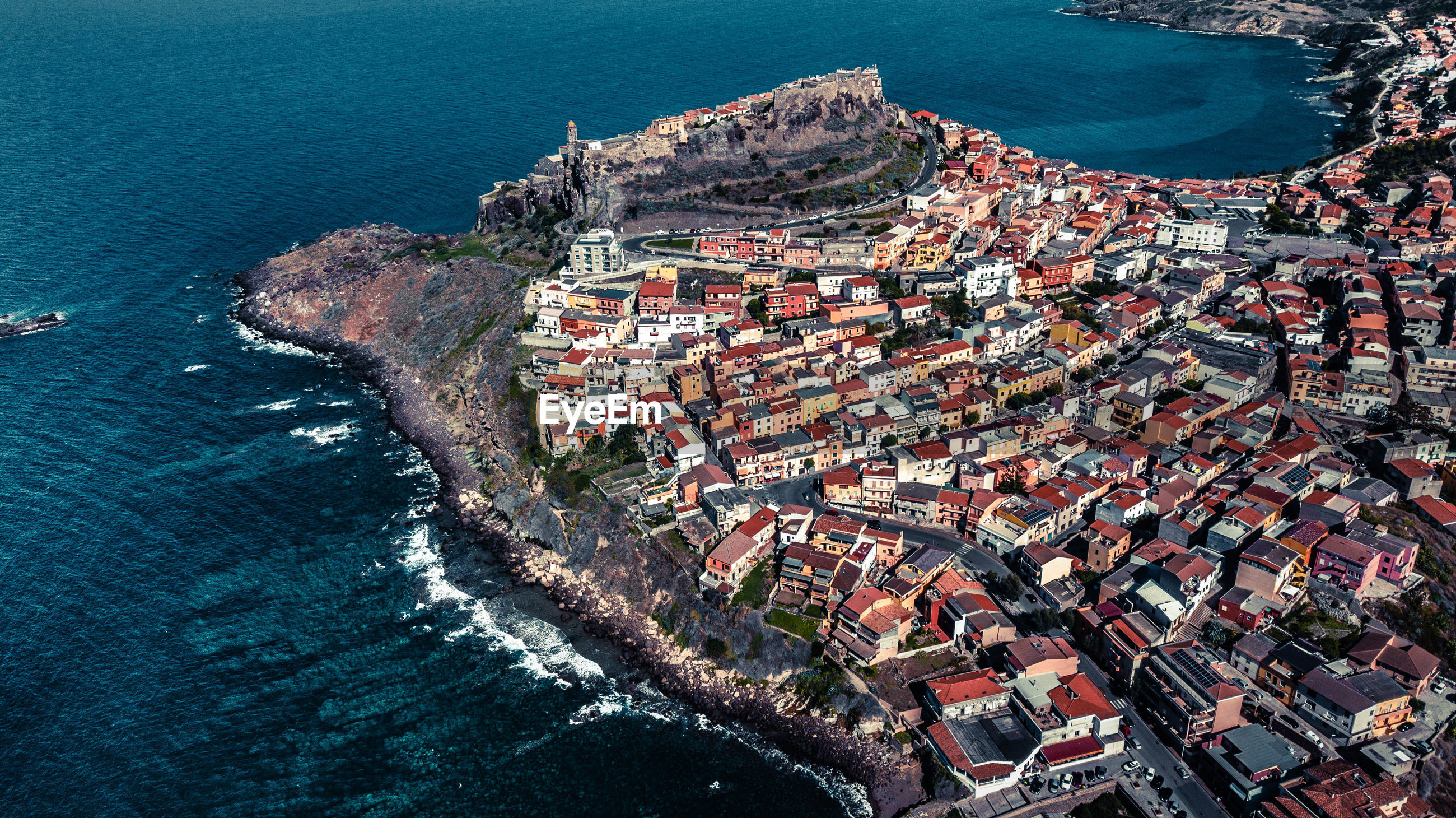 Aerial view of townscape by sea
