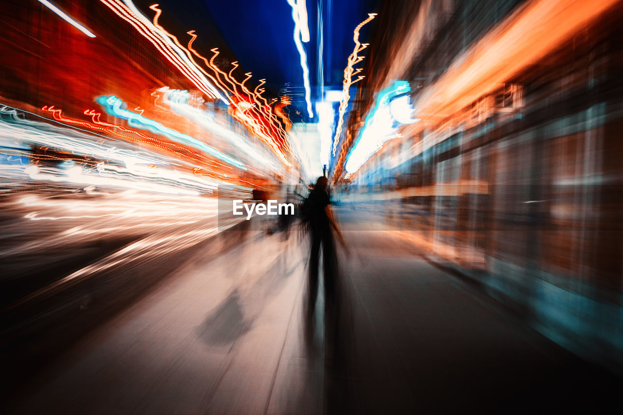 Blurred Motion Of People In City At Night