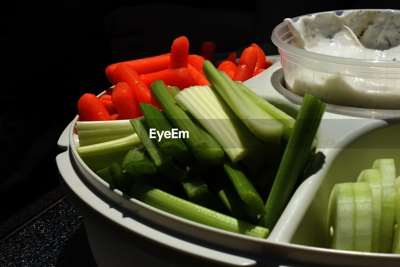 vegetable, food, food and drink, freshness, healthy eating, indoors, wellbeing, still life, no people, green color, close-up, bowl, bell pepper, carrot, pepper, black background, root vegetable, chopped, container, raw food, vegetarian food