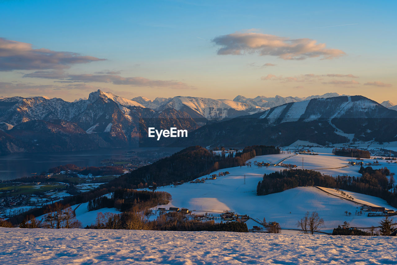 winter, cold temperature, mountain, snow, scenics - nature, sky, beauty in nature, mountain range, sunset, tranquil scene, tranquility, cloud - sky, water, environment, snowcapped mountain, nature, no people, non-urban scene, mountain peak