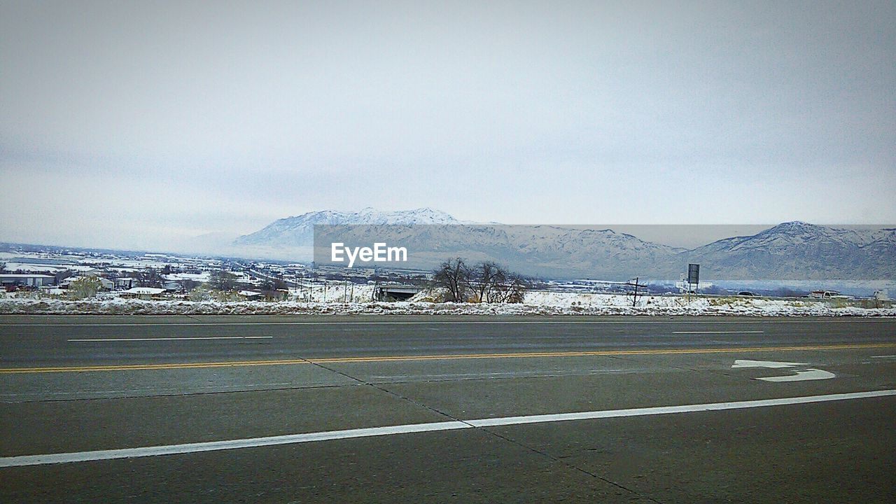 mountain, mountain range, transportation, road, day, no people, sky, outdoors, snow, scenics, airport runway, nature, beauty in nature, landscape, winter, clear sky
