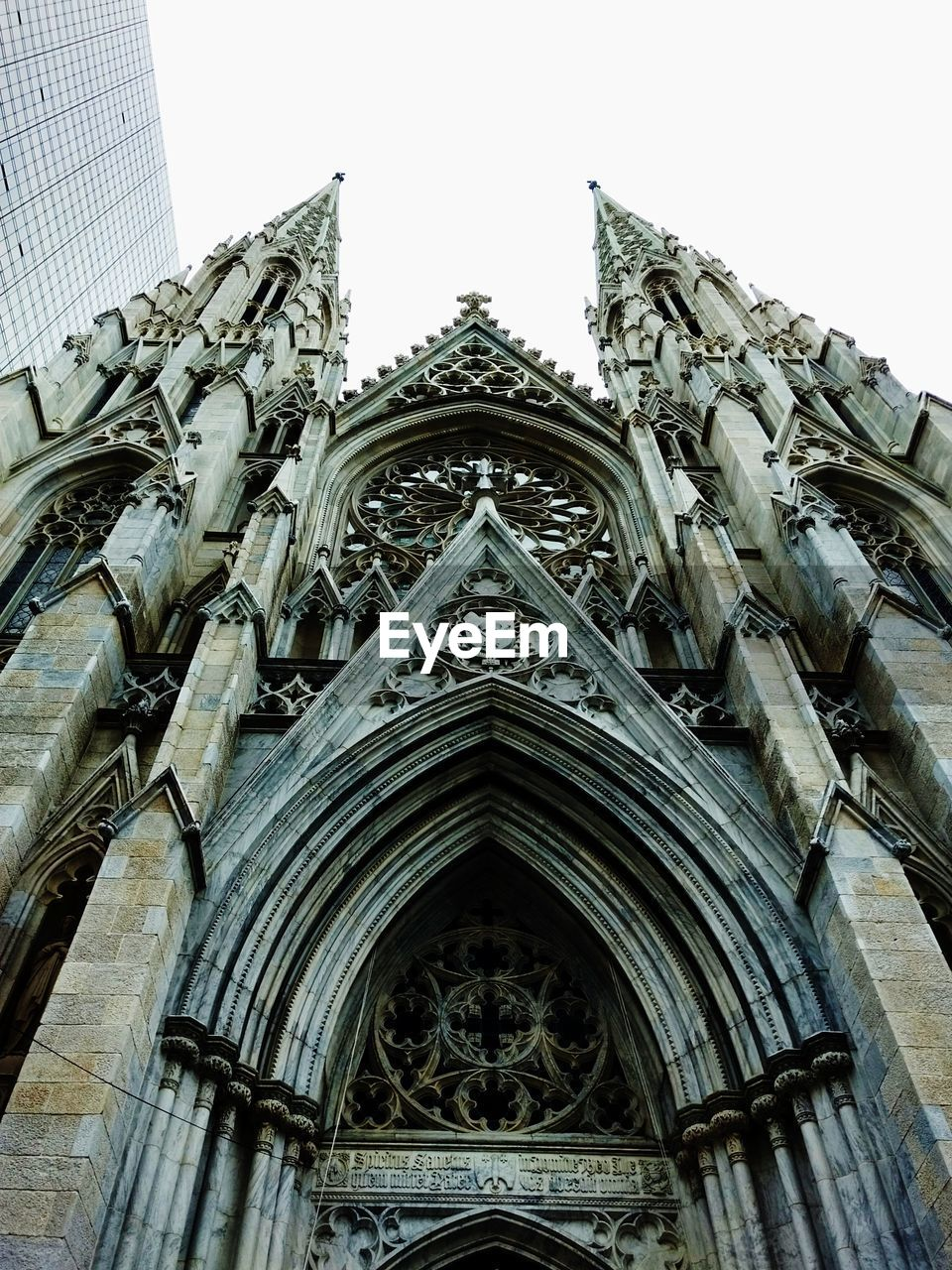 built structure, architecture, building exterior, low angle view, religion, spirituality, belief, place of worship, building, the past, history, sky, no people, day, arch, travel destinations, outdoors, gothic style, ornate