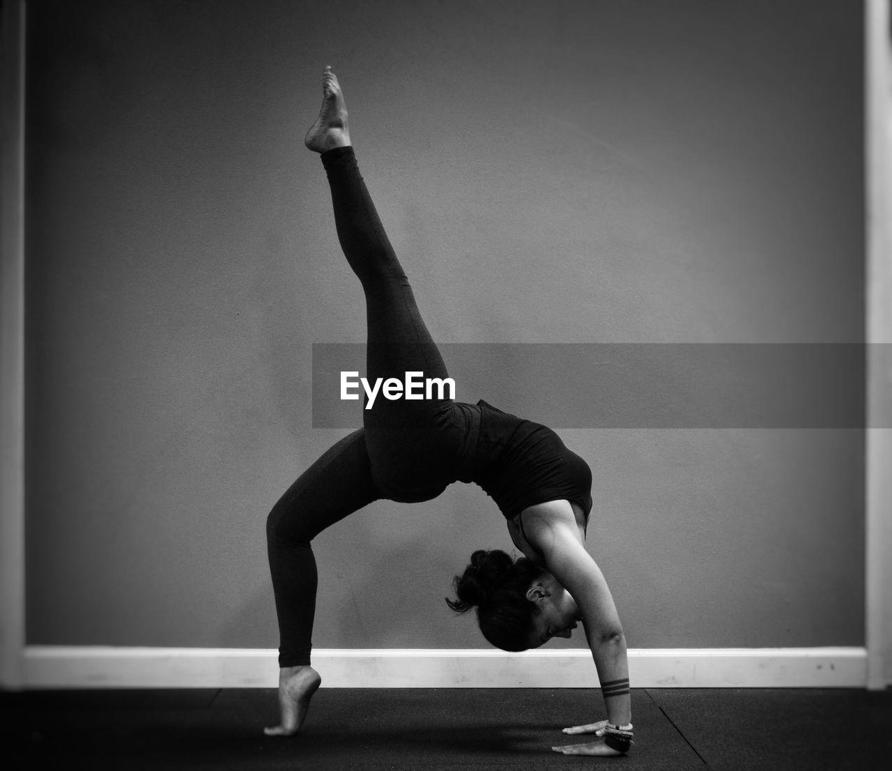 Woman Performing Cartwheel At Gymnasium