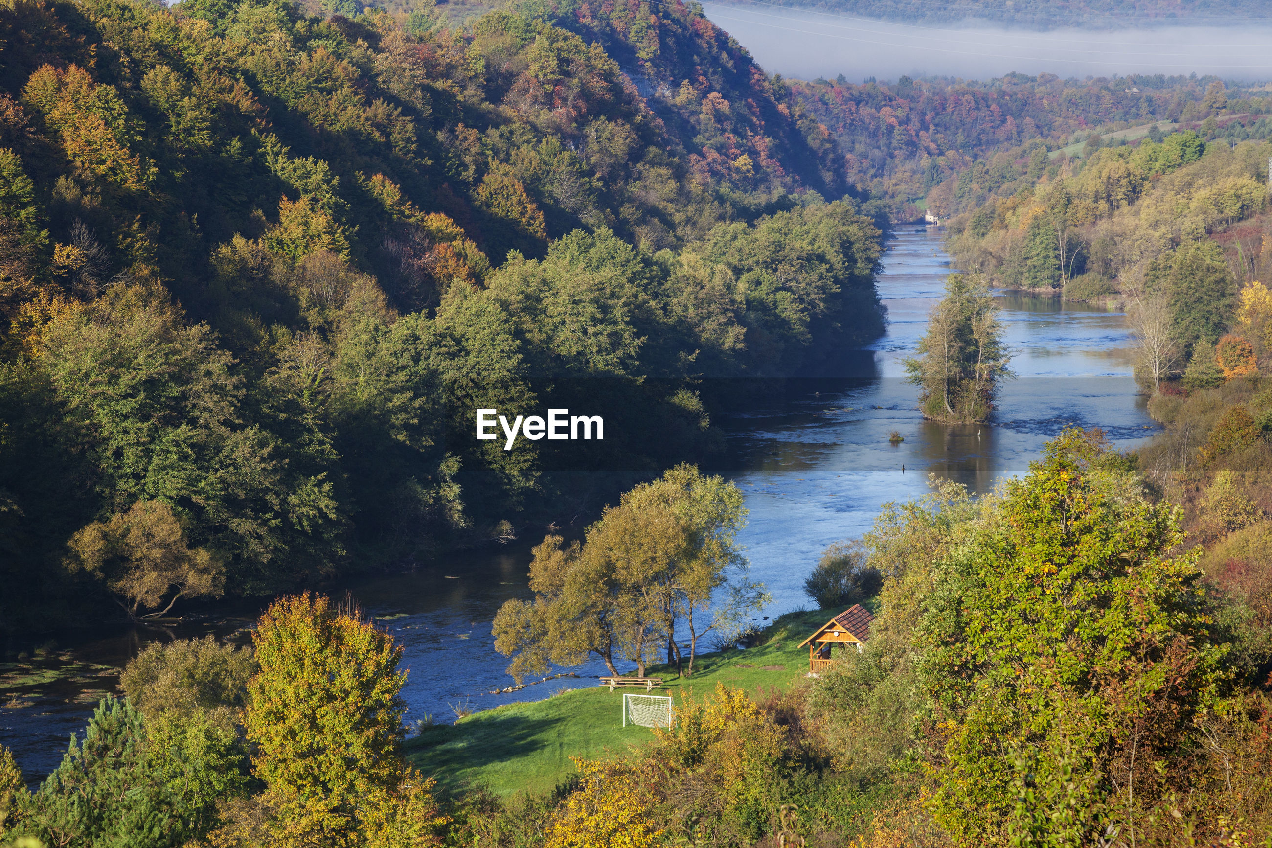 High angle view of lake amidst trees in forest during autumn