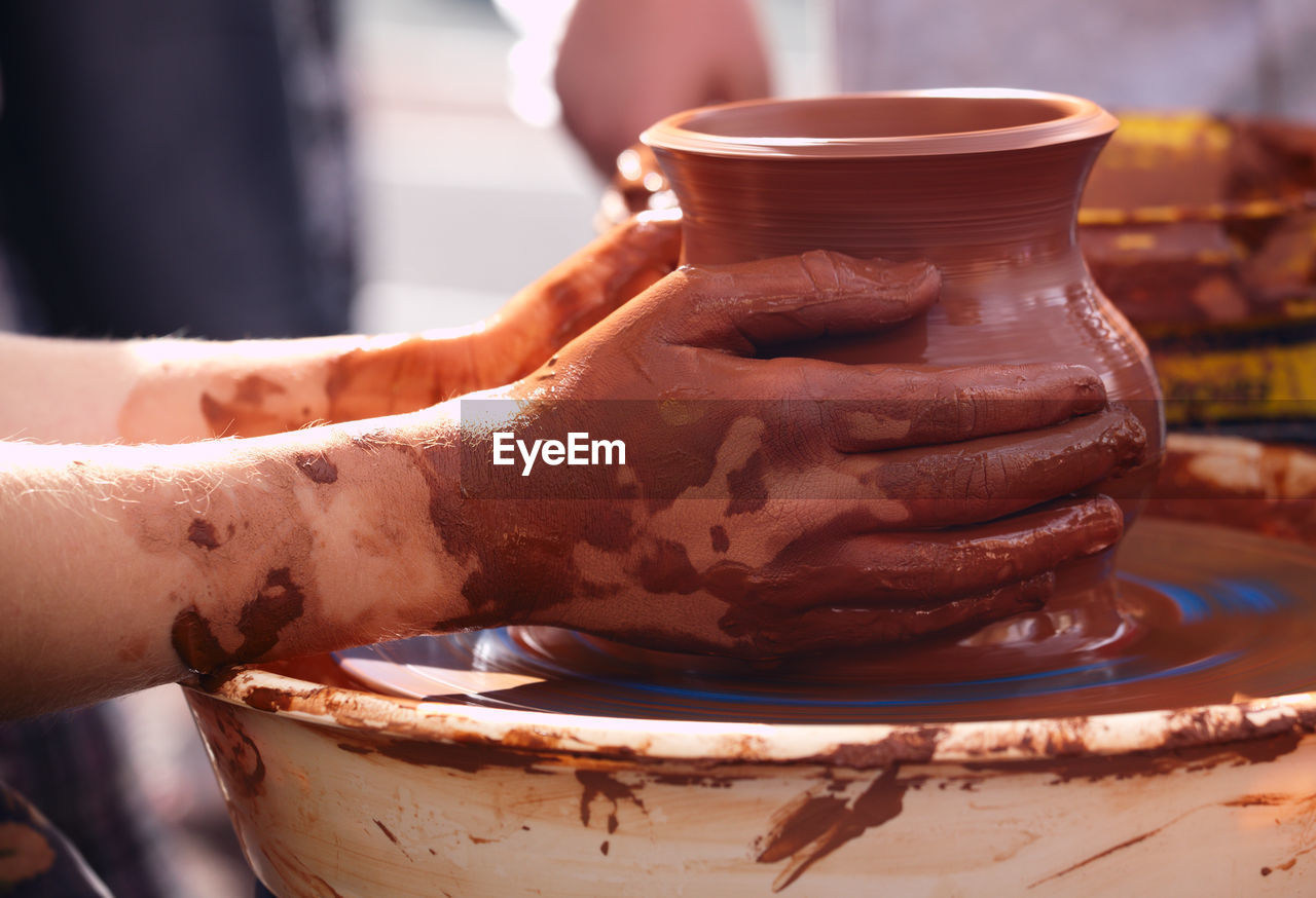 Cropped Hands Making Clay Pot