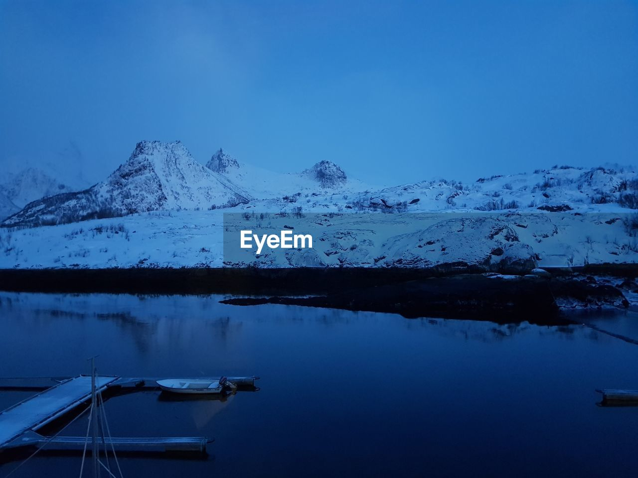 winter, cold temperature, snow, scenics - nature, water, beauty in nature, mountain, sky, tranquility, tranquil scene, snowcapped mountain, reflection, lake, blue, nature, non-urban scene, no people, mountain range, ice