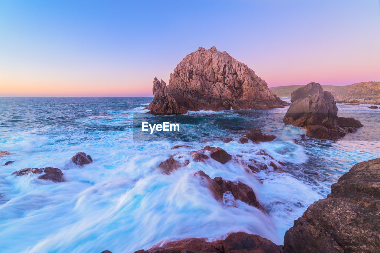 sea, water, sky, rock, beauty in nature, scenics - nature, rock - object, solid, horizon over water, horizon, beach, land, motion, nature, tranquility, idyllic, sunset, rock formation, tranquil scene, no people, outdoors, stack rock