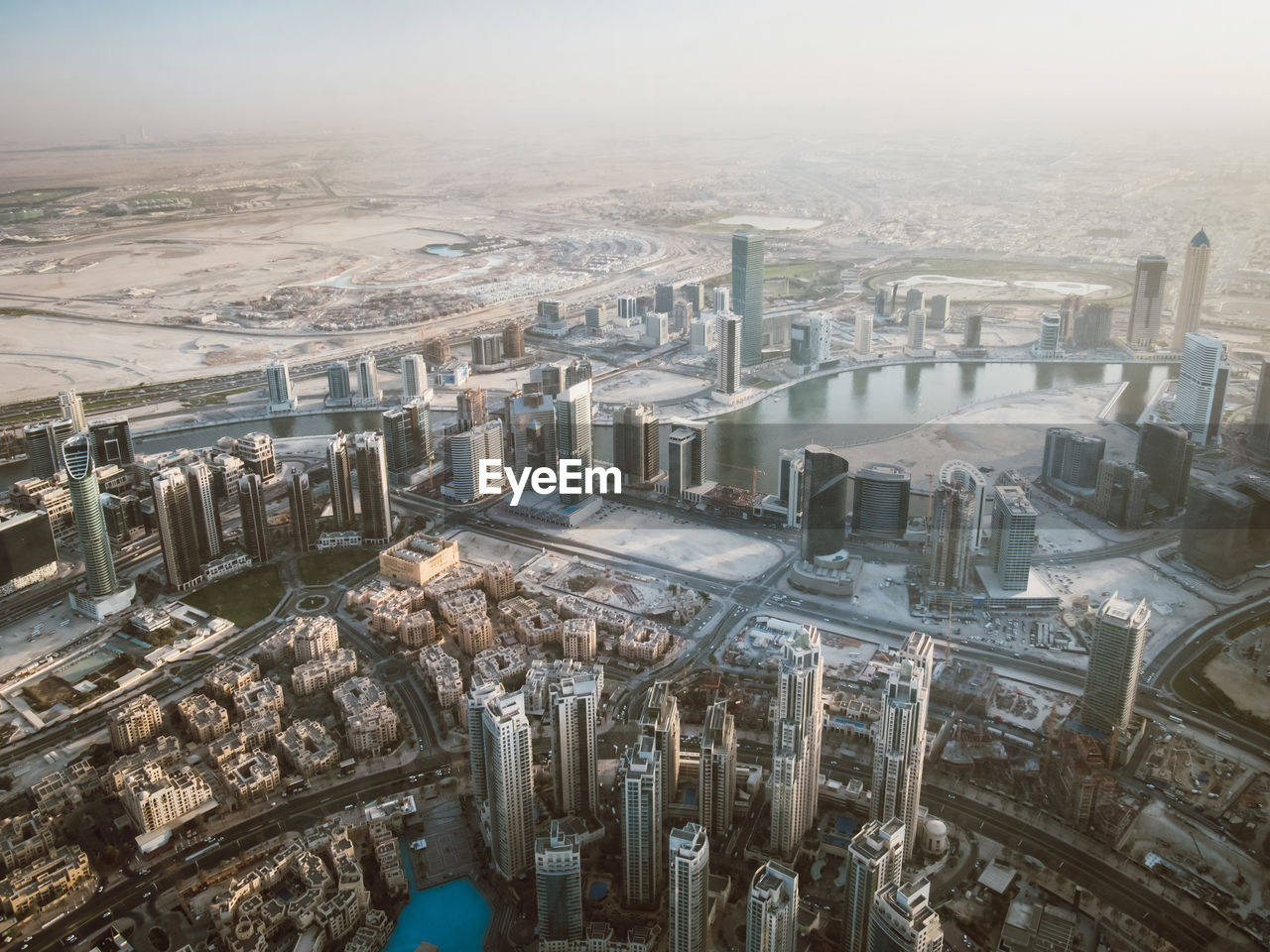 high angle view, architecture, industry, no people, aerial view, built structure, day, nature, factory, building exterior, city, cityscape, outdoors, technology, environment, industrial equipment, sky, fuel and power generation, business, large group of objects, pollution