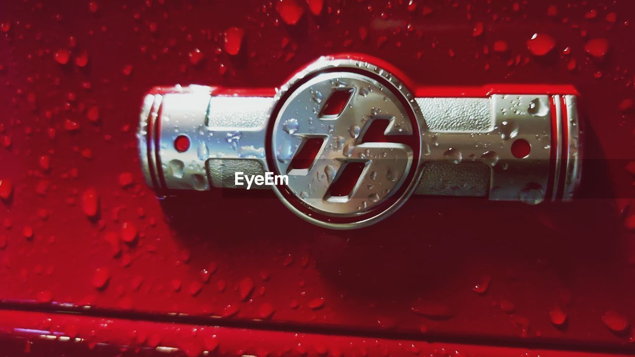 CLOSE-UP OF CAR ON RED METAL