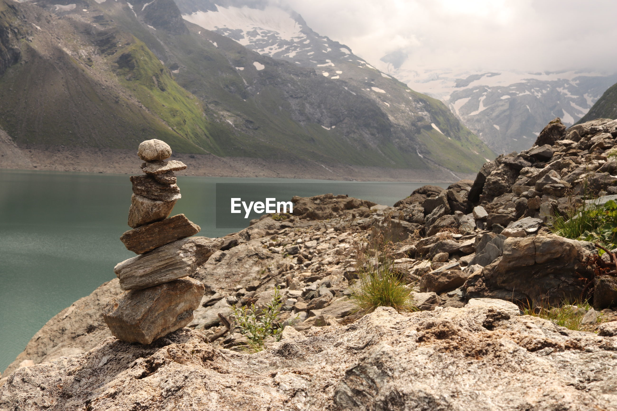 Scenic view of rock and mountains against sky