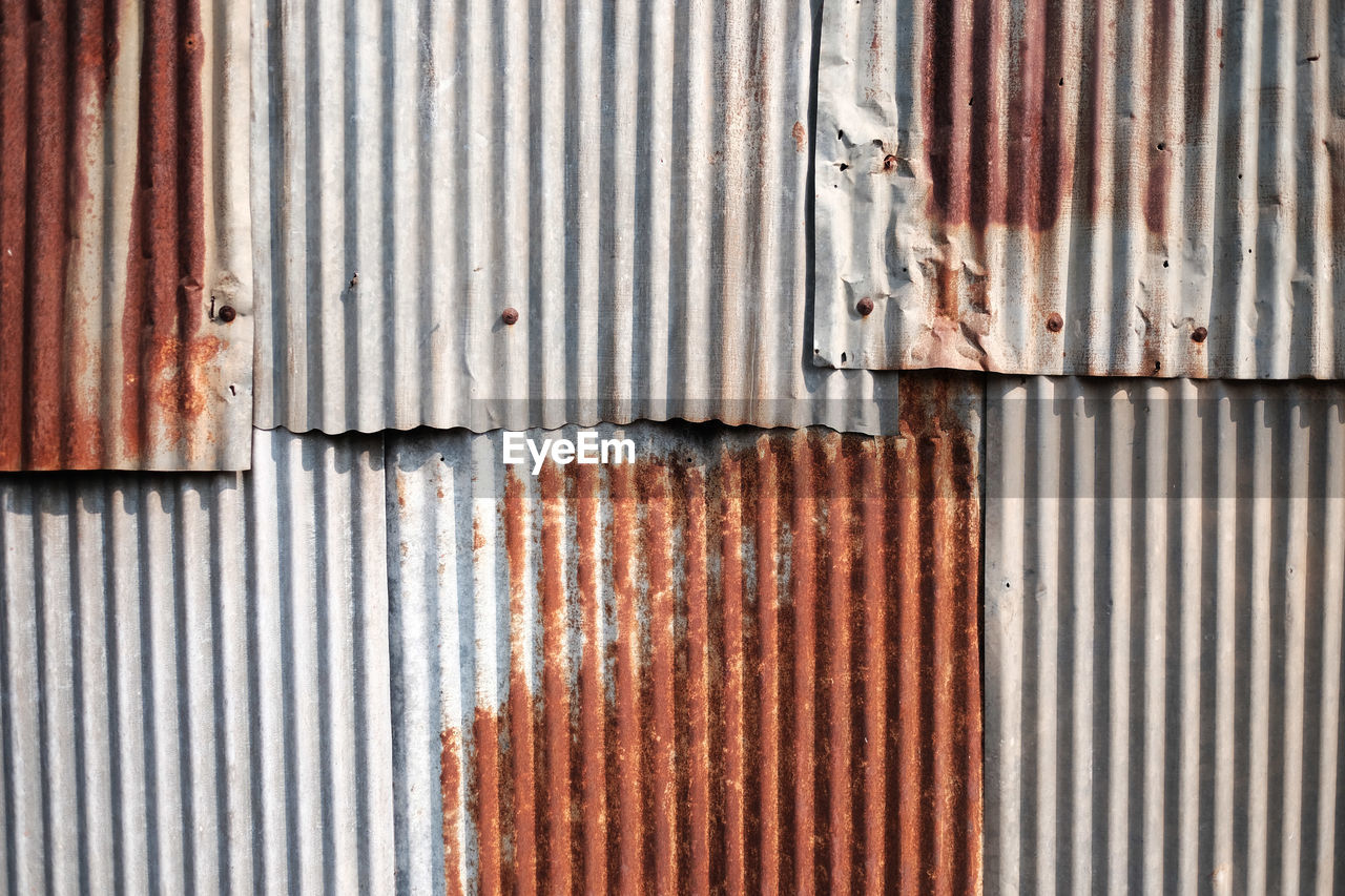 iron, corrugated iron, corrugated, metal, rusty, pattern, full frame, backgrounds, old, no people, textured, day, architecture, weathered, sheet metal, damaged, striped, built structure, bad condition, wall - building feature, deterioration, iron - metal
