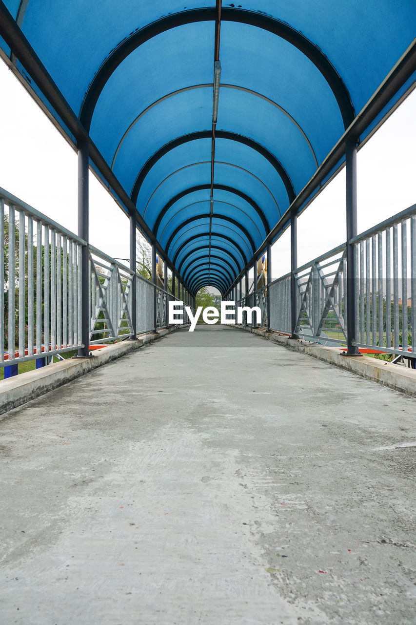 in a row, the way forward, day, diminishing perspective, architecture, built structure, transportation, empty, no people, arch, indoors, bridge - man made structure, greenhouse, sky