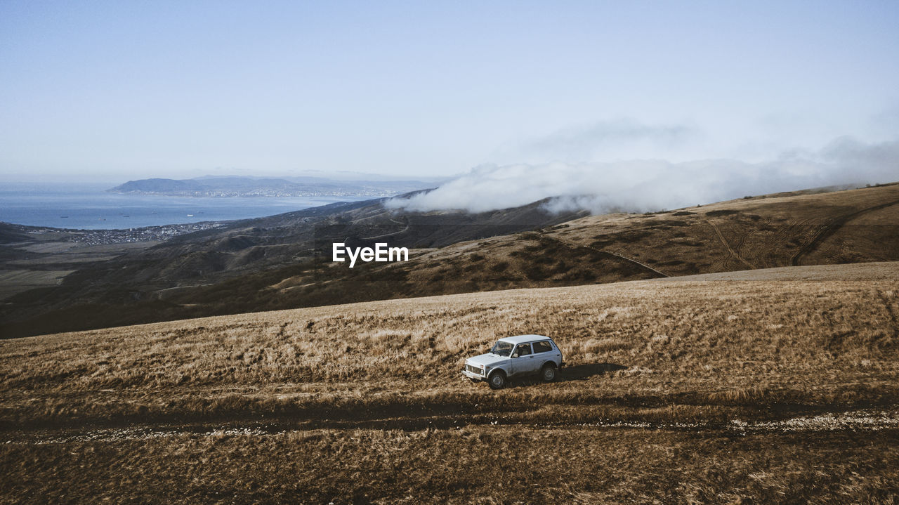Car On Landscape Against Sky