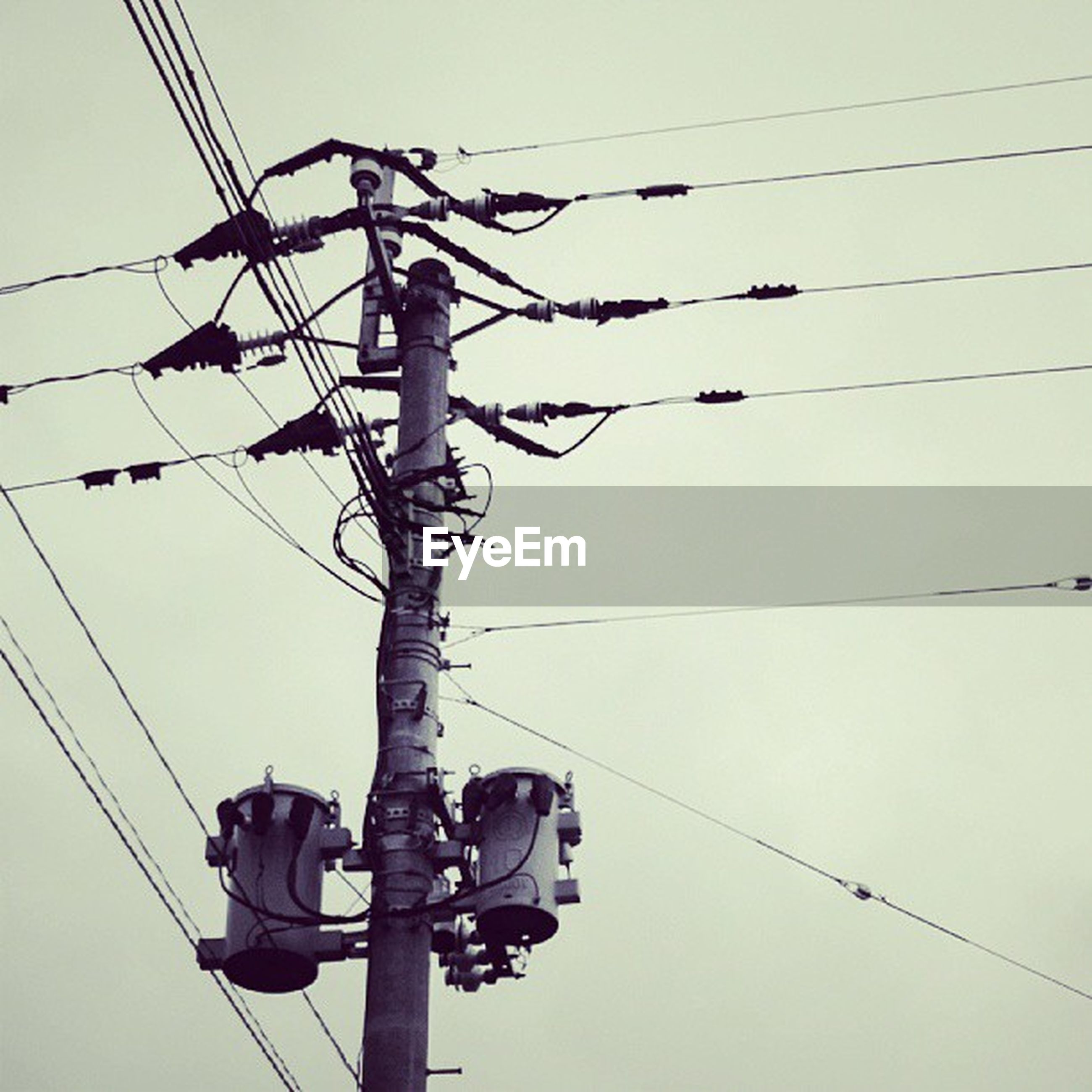 power line, cable, low angle view, power supply, electricity, electricity pylon, technology, connection, fuel and power generation, power cable, clear sky, sky, hanging, complexity, silhouette, rope, lighting equipment, pole, wire, outdoors