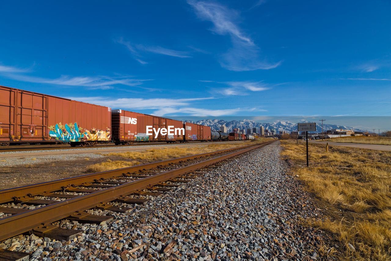 transportation, railroad track, rail transportation, sky, train - vehicle, freight transportation, day, mode of transport, outdoors, no people, cloud - sky, cargo container