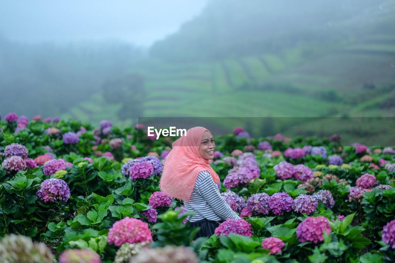 PINK FLOWERS ON FIELD