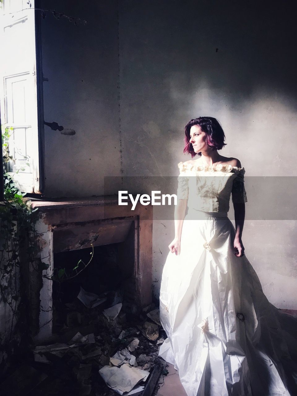 Bride standing on floor in abandoned building