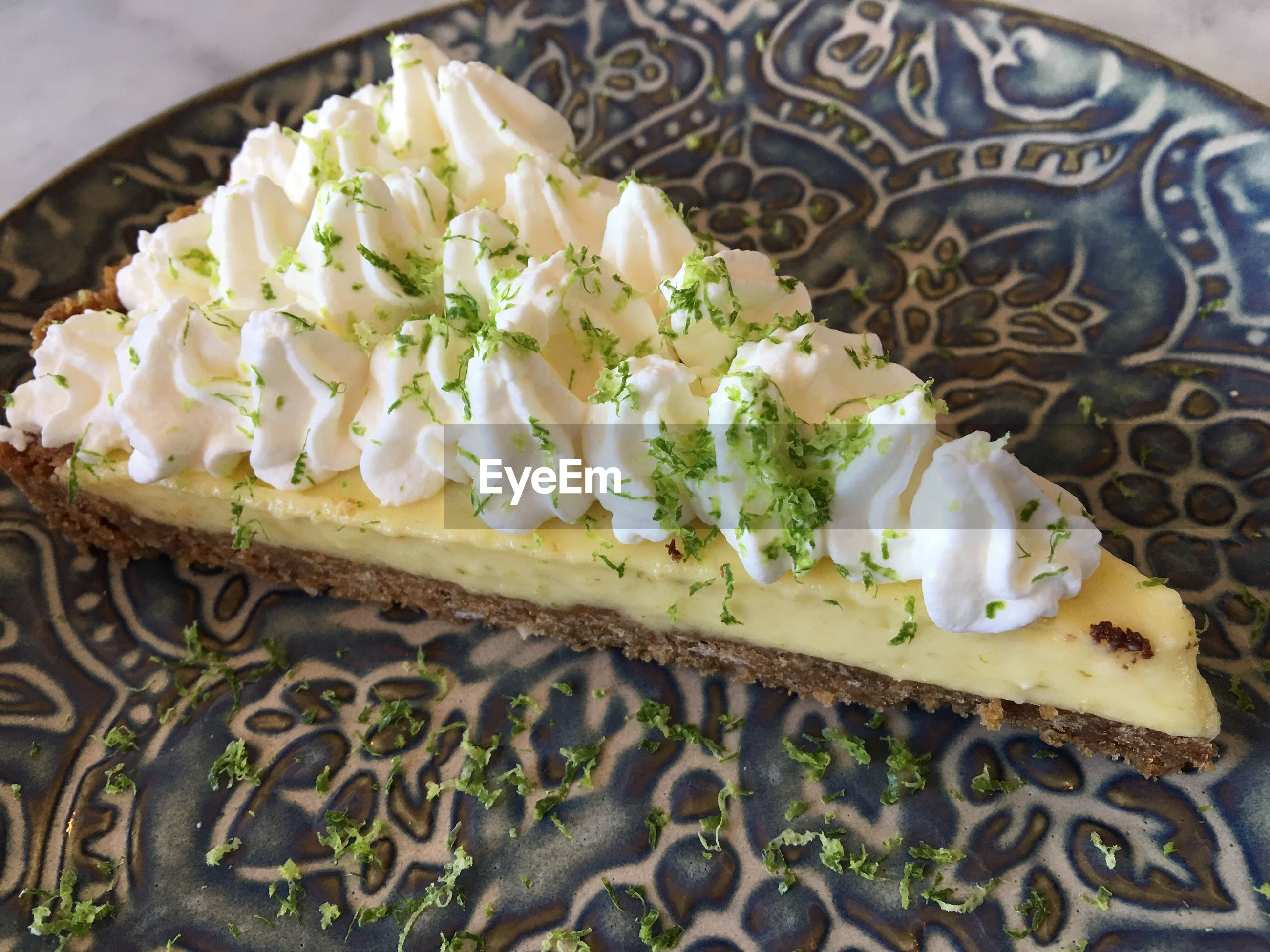 High angle view of key lime pie slice on table