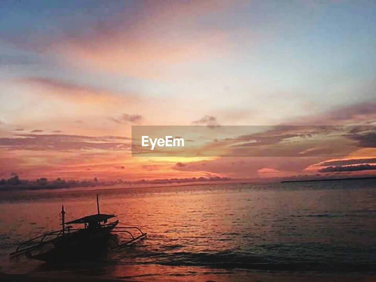 sunset, water, sea, beauty in nature, nature, scenics, tranquility, sky, cloud - sky, silhouette, beach, no people, outdoors, nautical vessel, horizon over water