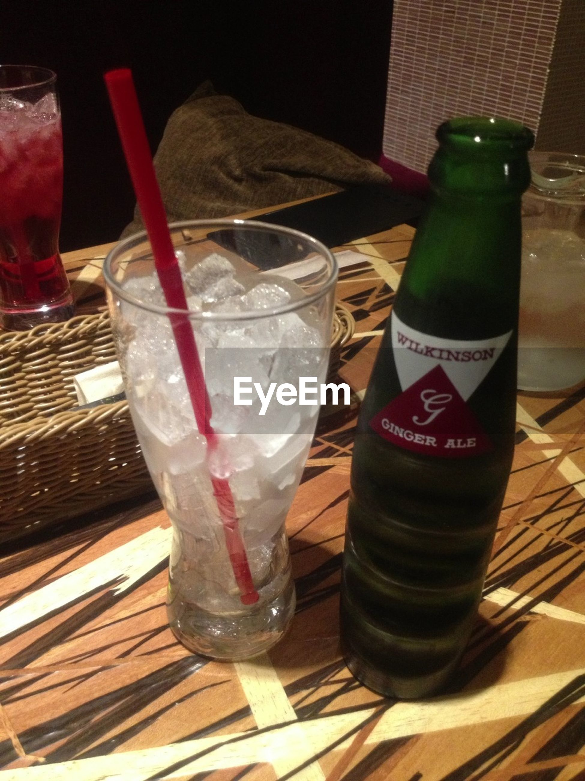 drink, food and drink, drinking glass, refreshment, table, freshness, indoors, still life, alcohol, glass - material, close-up, drinking straw, wood - material, glass, beer glass, cold temperature, cocktail, ice cube, restaurant, transparent