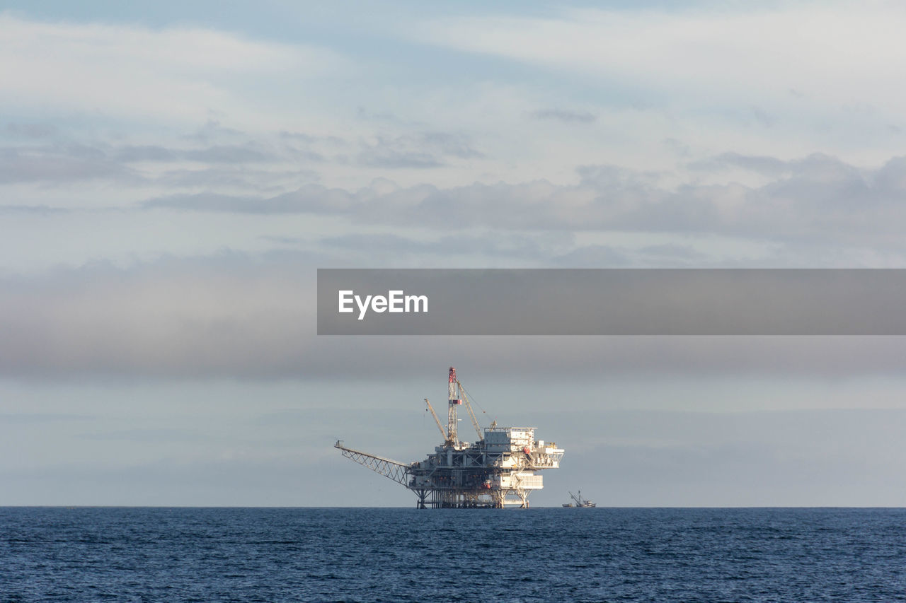 water, cloud - sky, sea, sky, industry, offshore platform, oil industry, nature, no people, drilling rig, fuel and power generation, day, nautical vessel, waterfront, ship, outdoors, transportation, crane - construction machinery, horizon