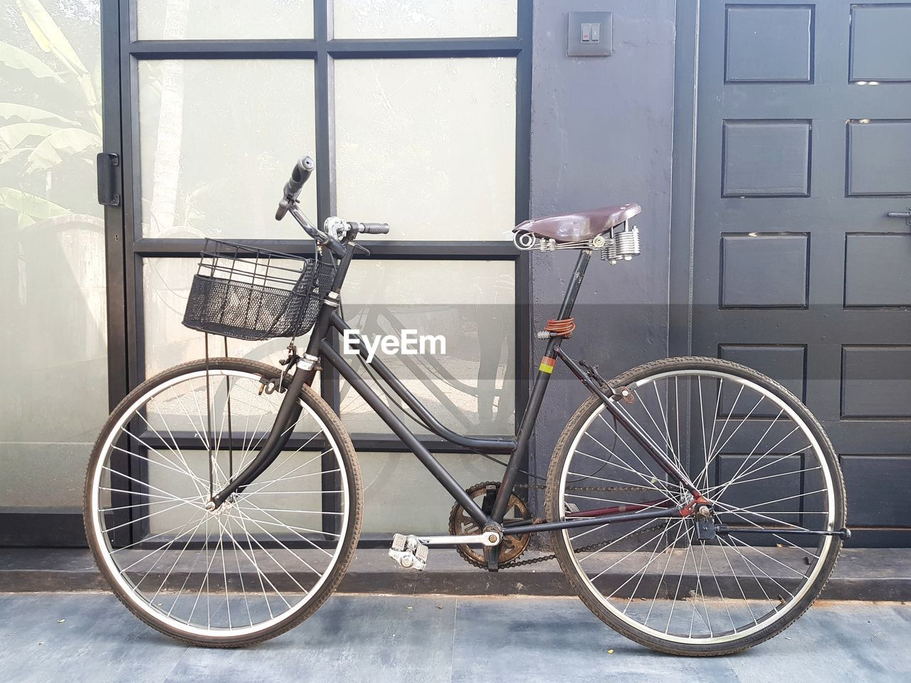 Bicycle parked against doors