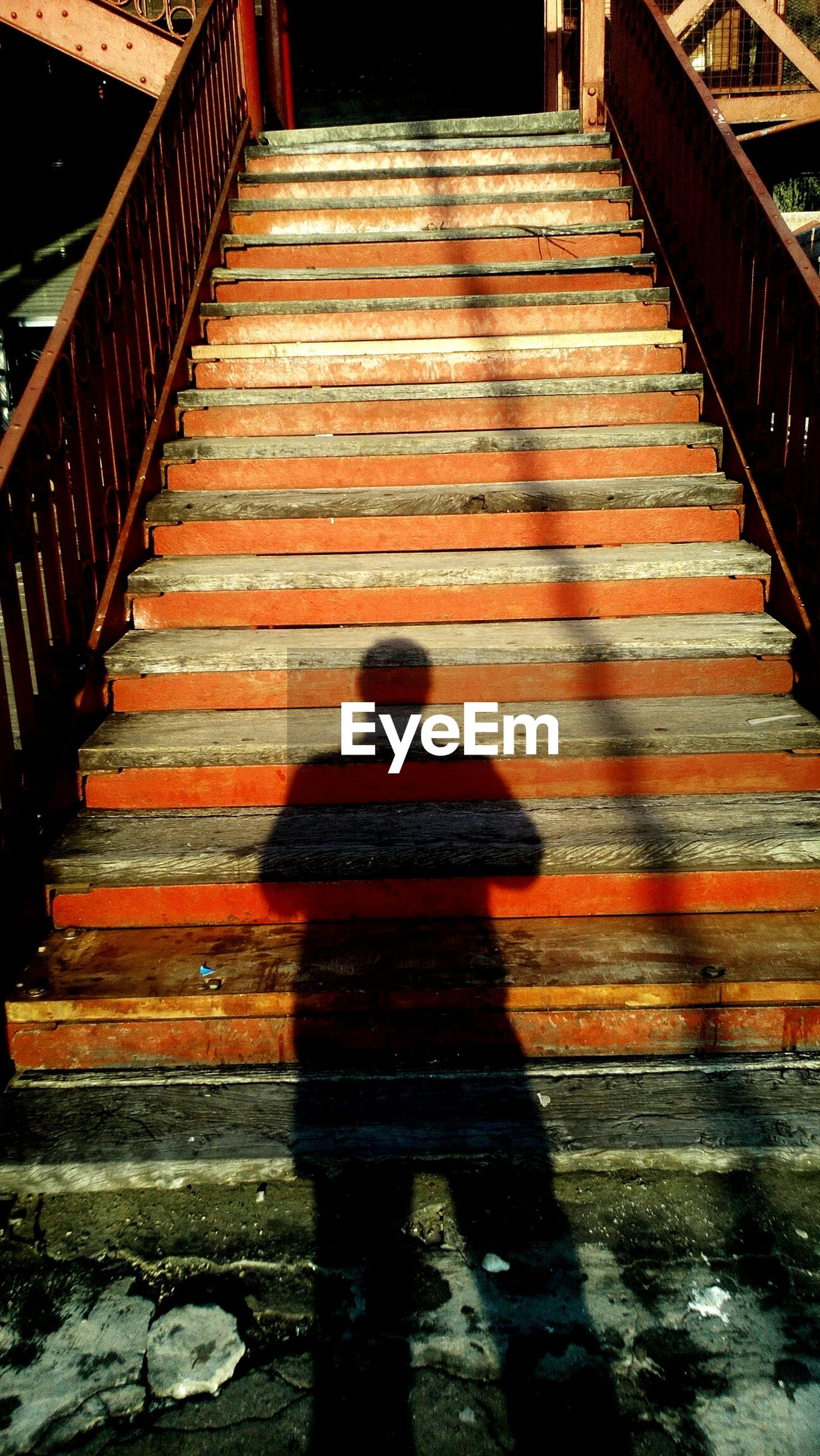 Shadow of man on staircase