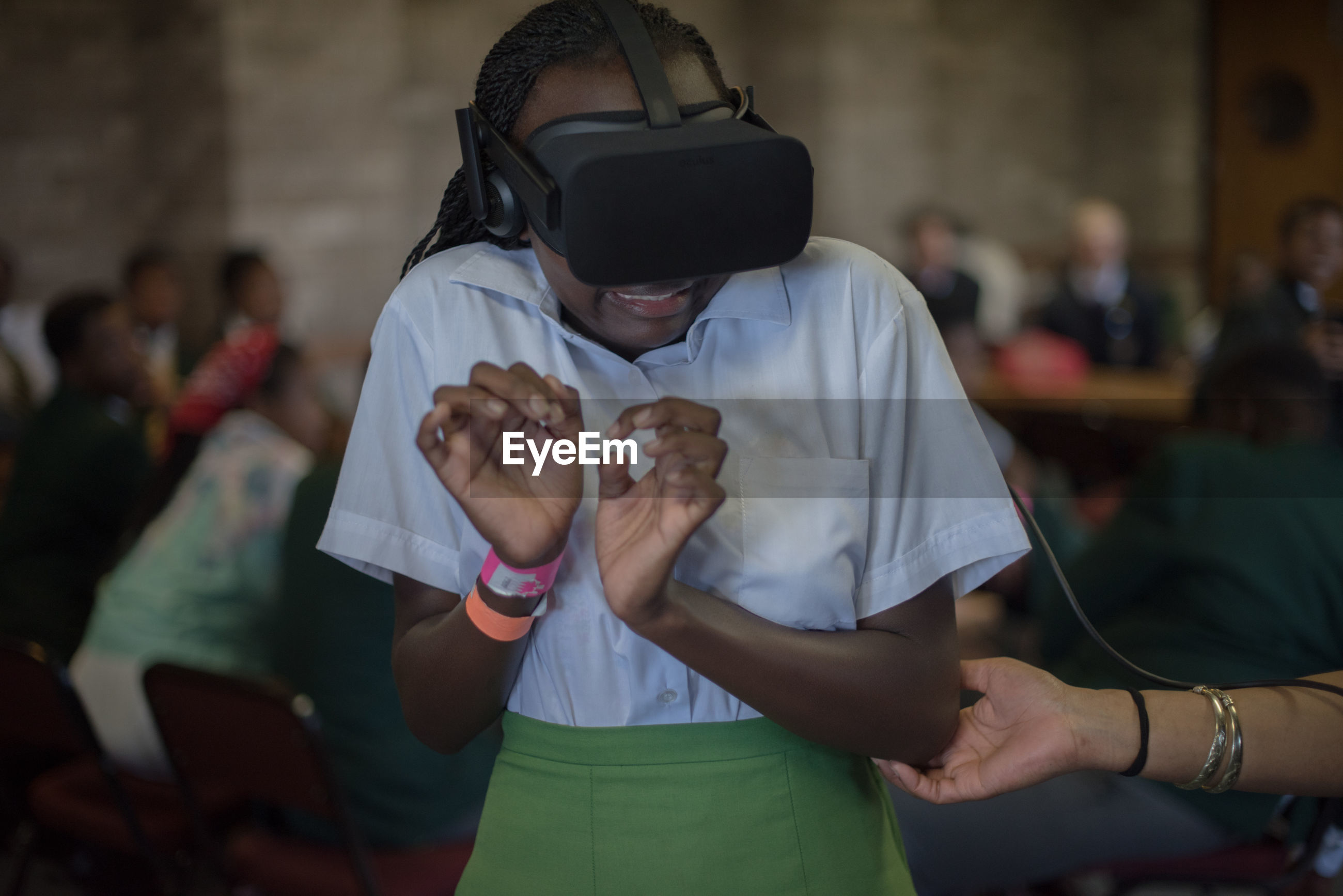 Student wearing virtual reality simulator in classroom