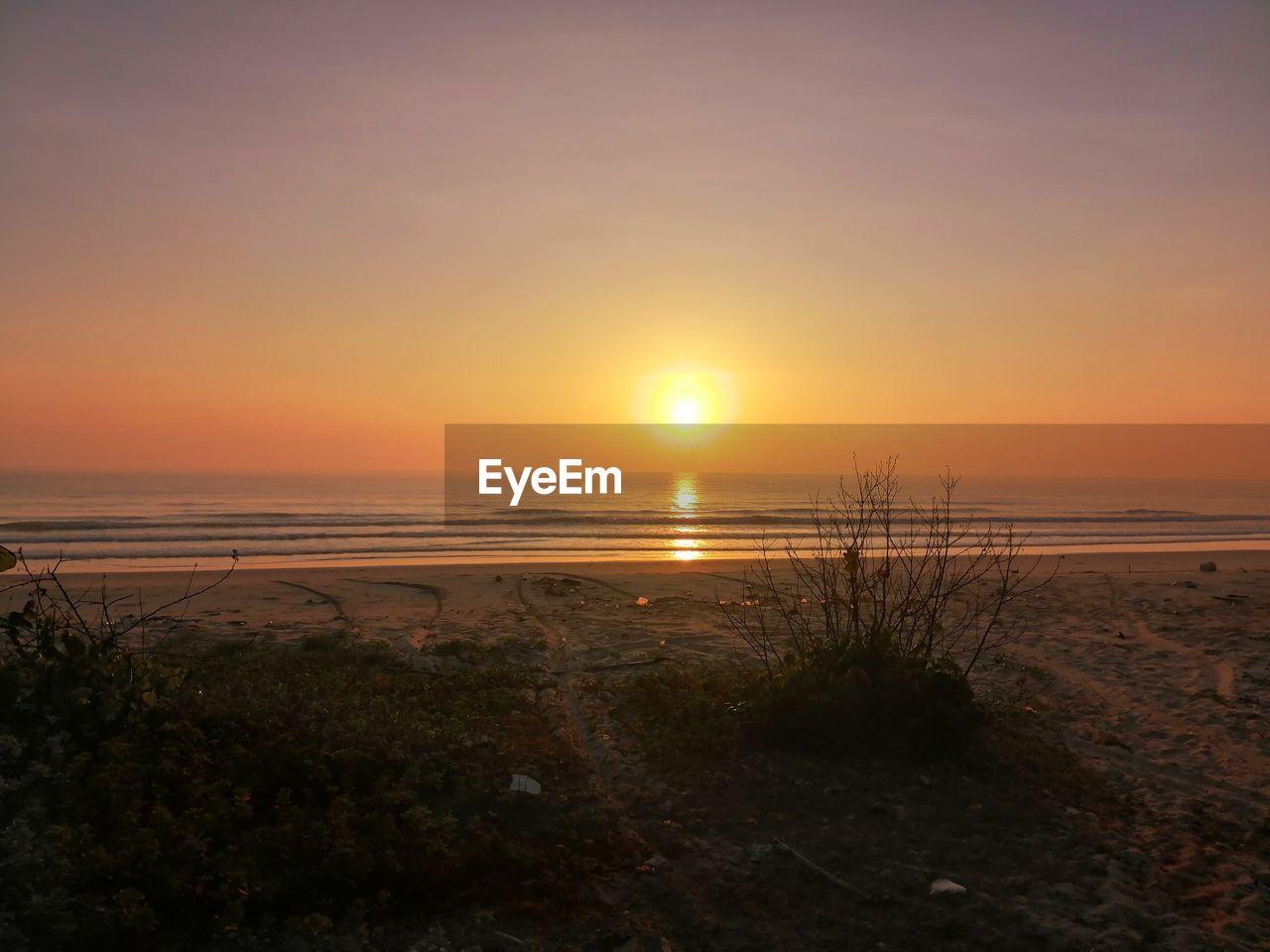 sky, sunset, water, sea, scenics - nature, beauty in nature, beach, land, tranquility, tranquil scene, sun, horizon, nature, horizon over water, no people, idyllic, orange color, non-urban scene, outdoors