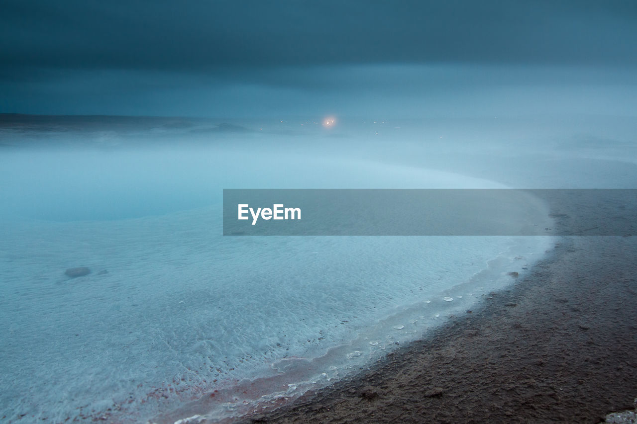 SCENIC VIEW OF SEA COVERED BY FOG